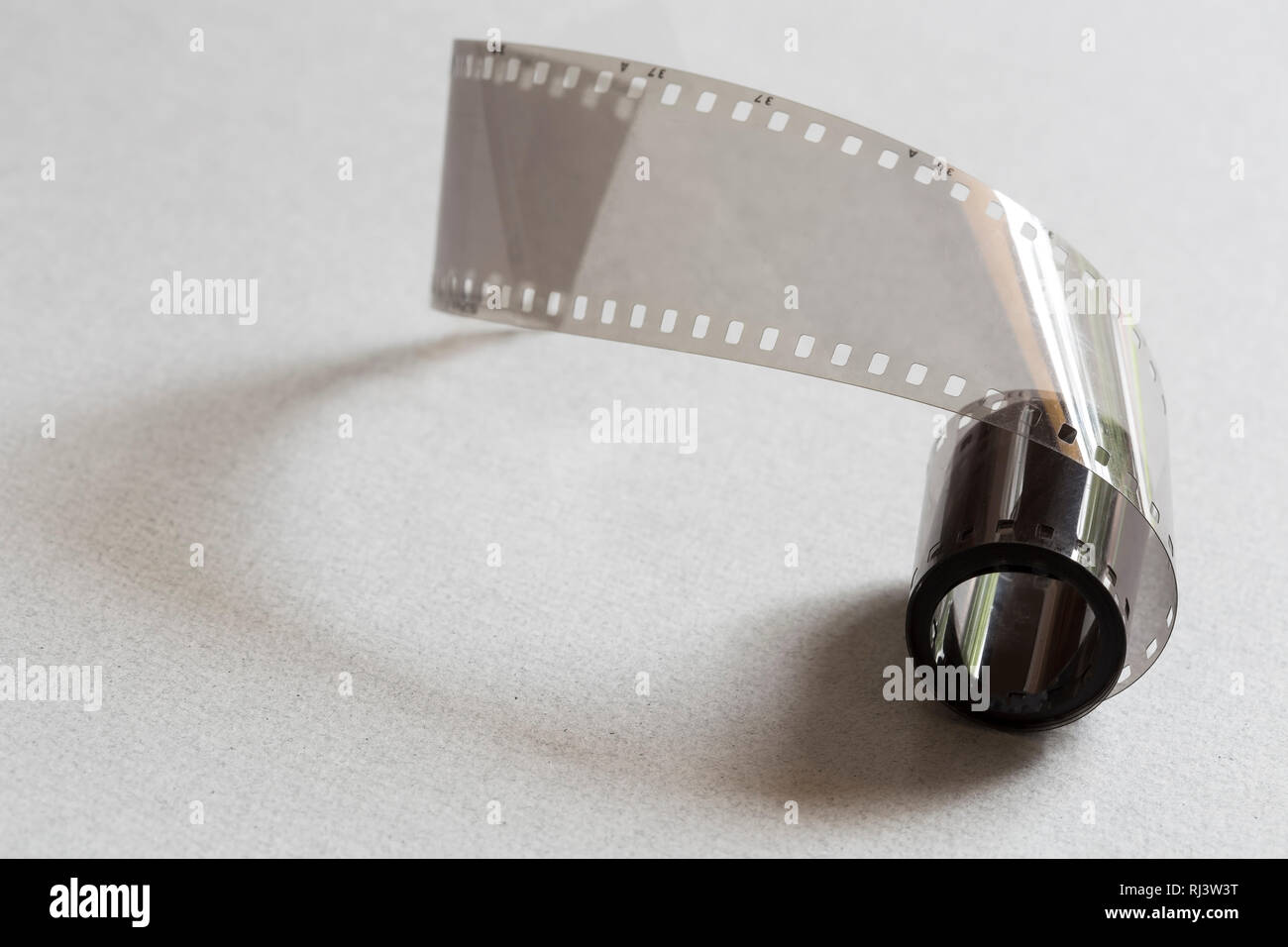 Film strip on a gray cardboard background Stock Photo