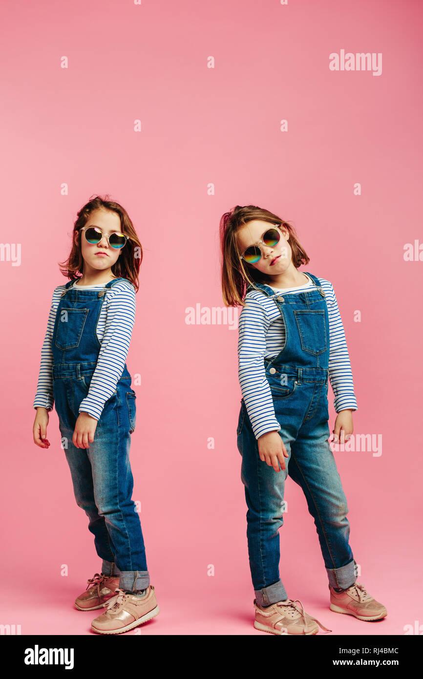 Stylish cute girls wearing fashion clothes. Girls posing in denim