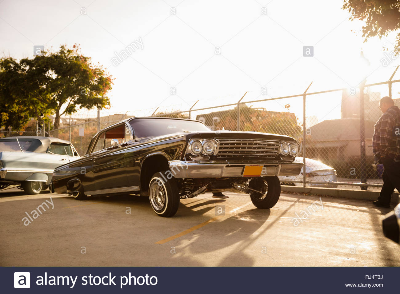 Low rider car in sunny parking lot - Stock Image