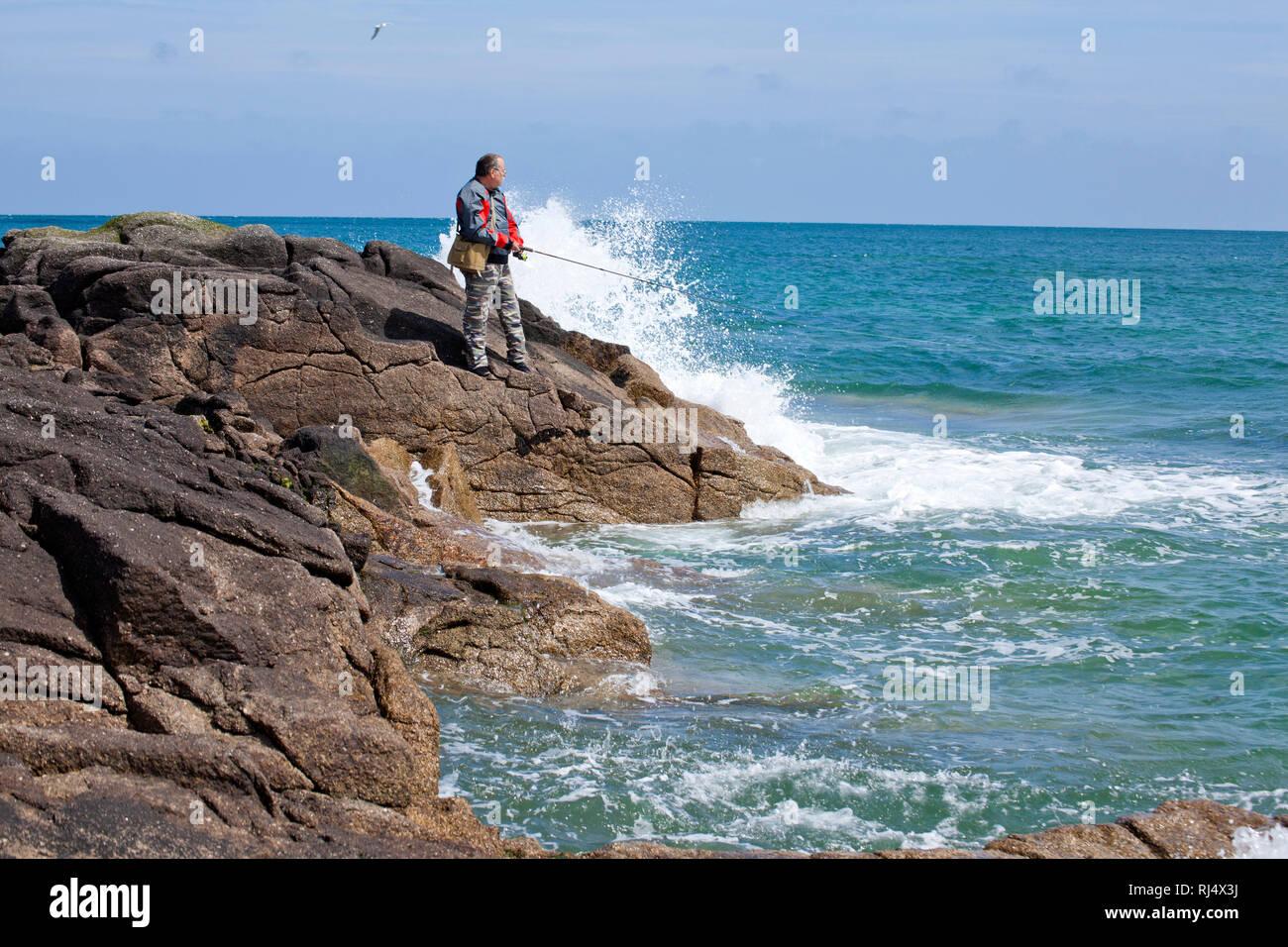 Hobbyangler am Meer Stock Photo