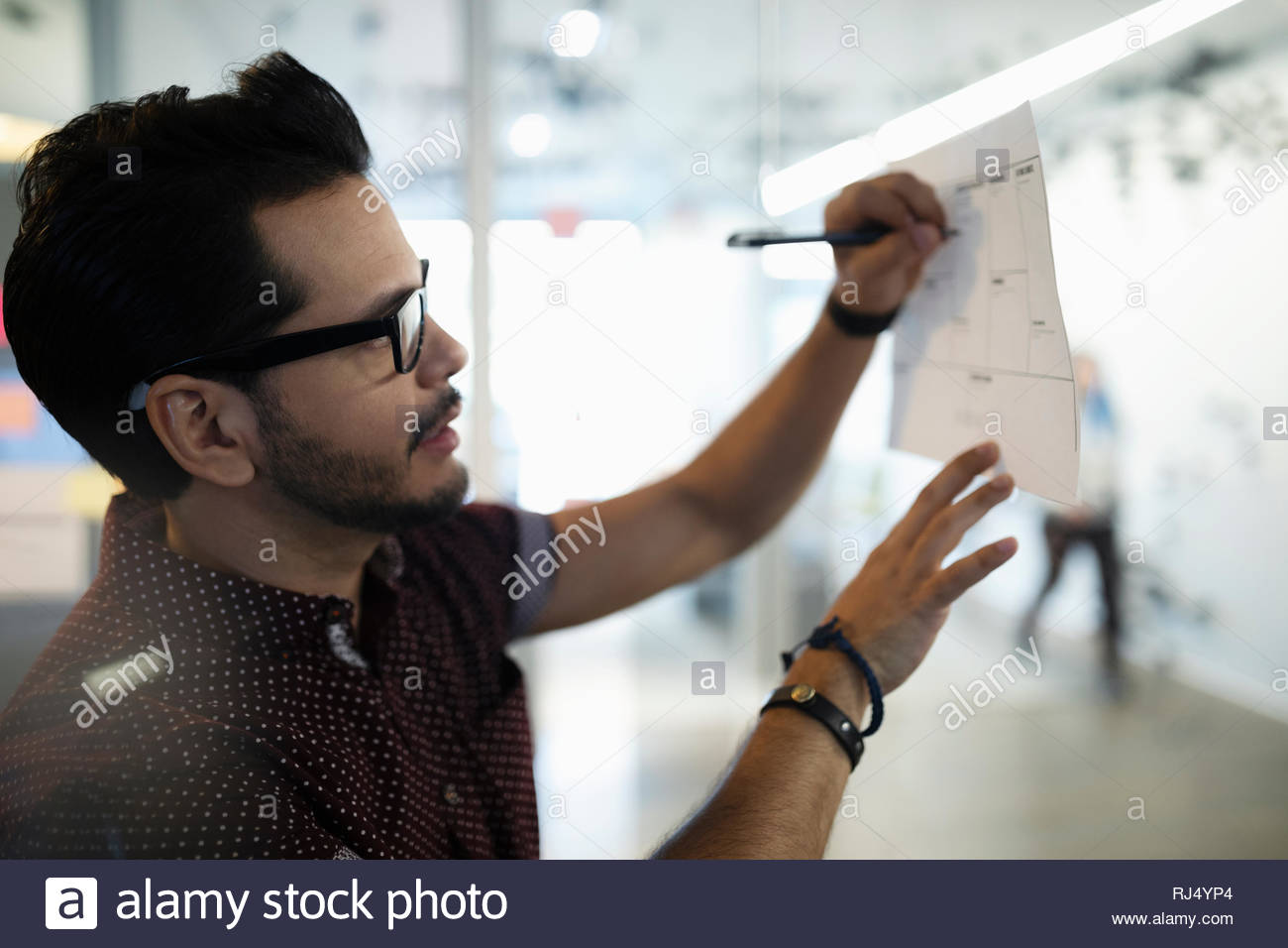 businessman scheduling, planning in office - Stock Image