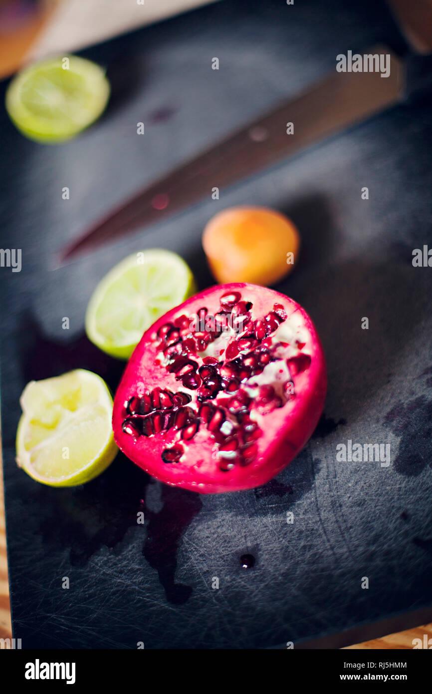 Fruits on cutting board Stock Photo