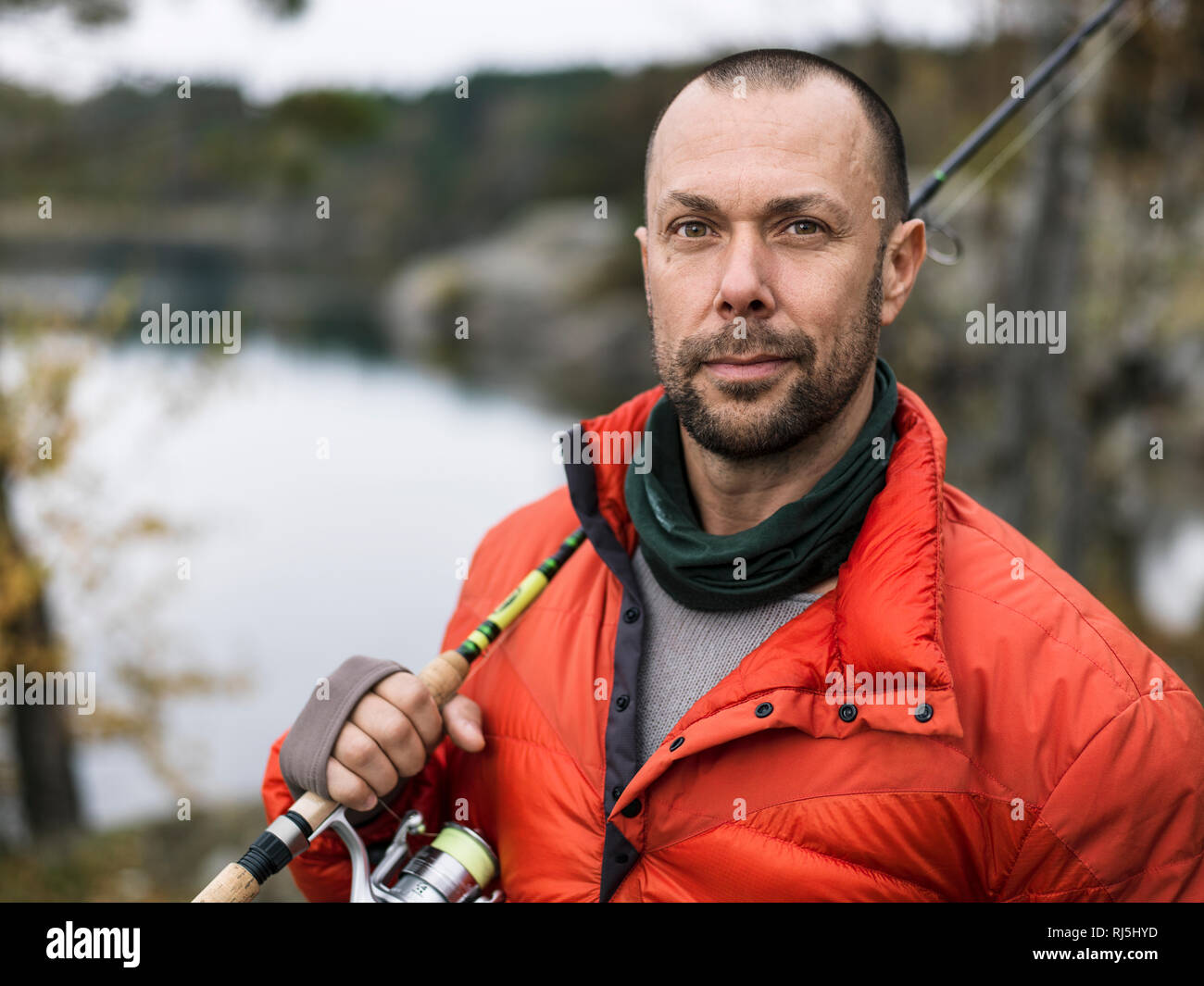 Portrait of man with fishing rod Stock Photo