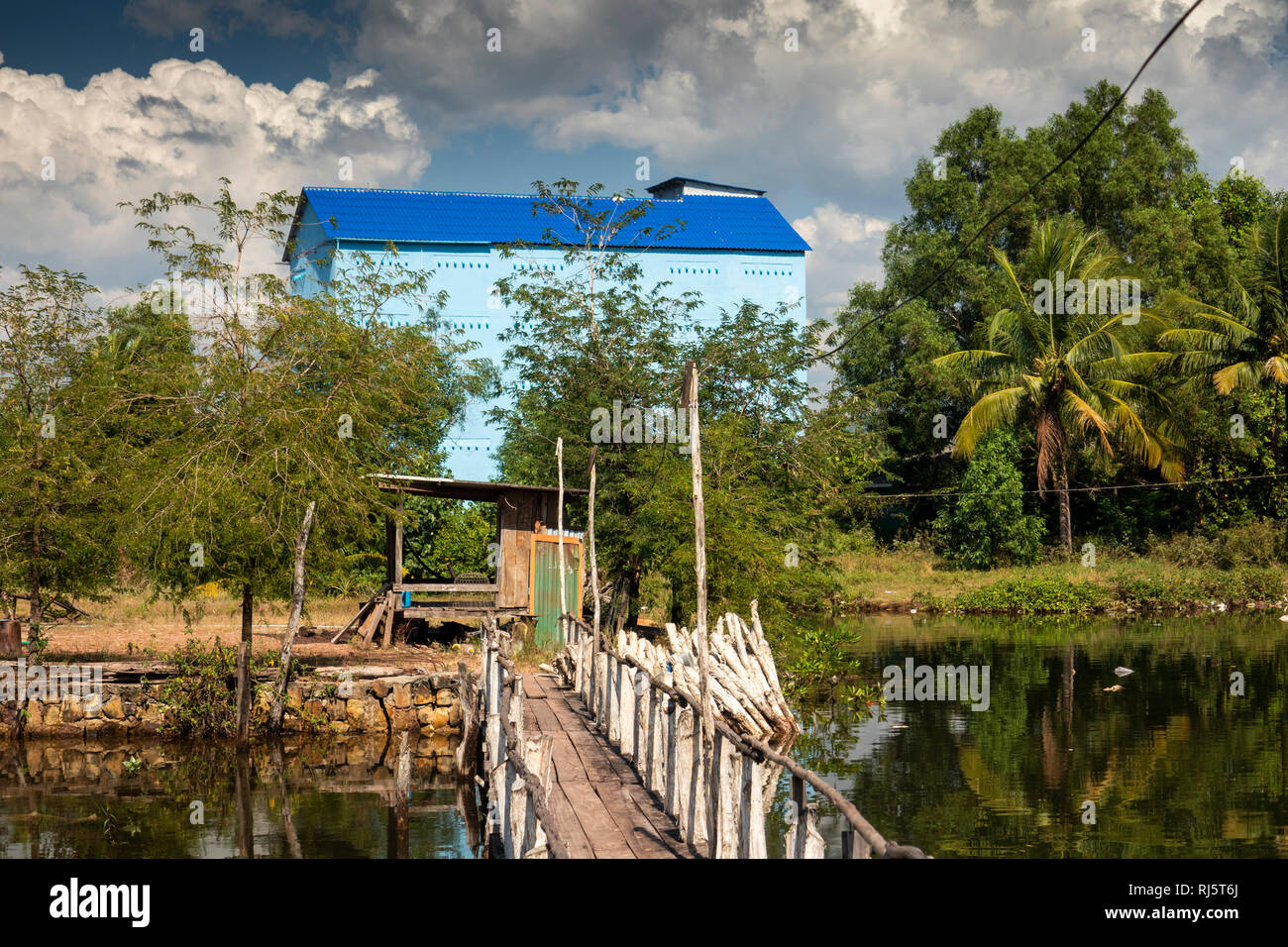 Cambodia, Preah Koh Kong, Krong Khemara Phoumin, building to house birds nest soup swiftlets beside waterway Stock Photo