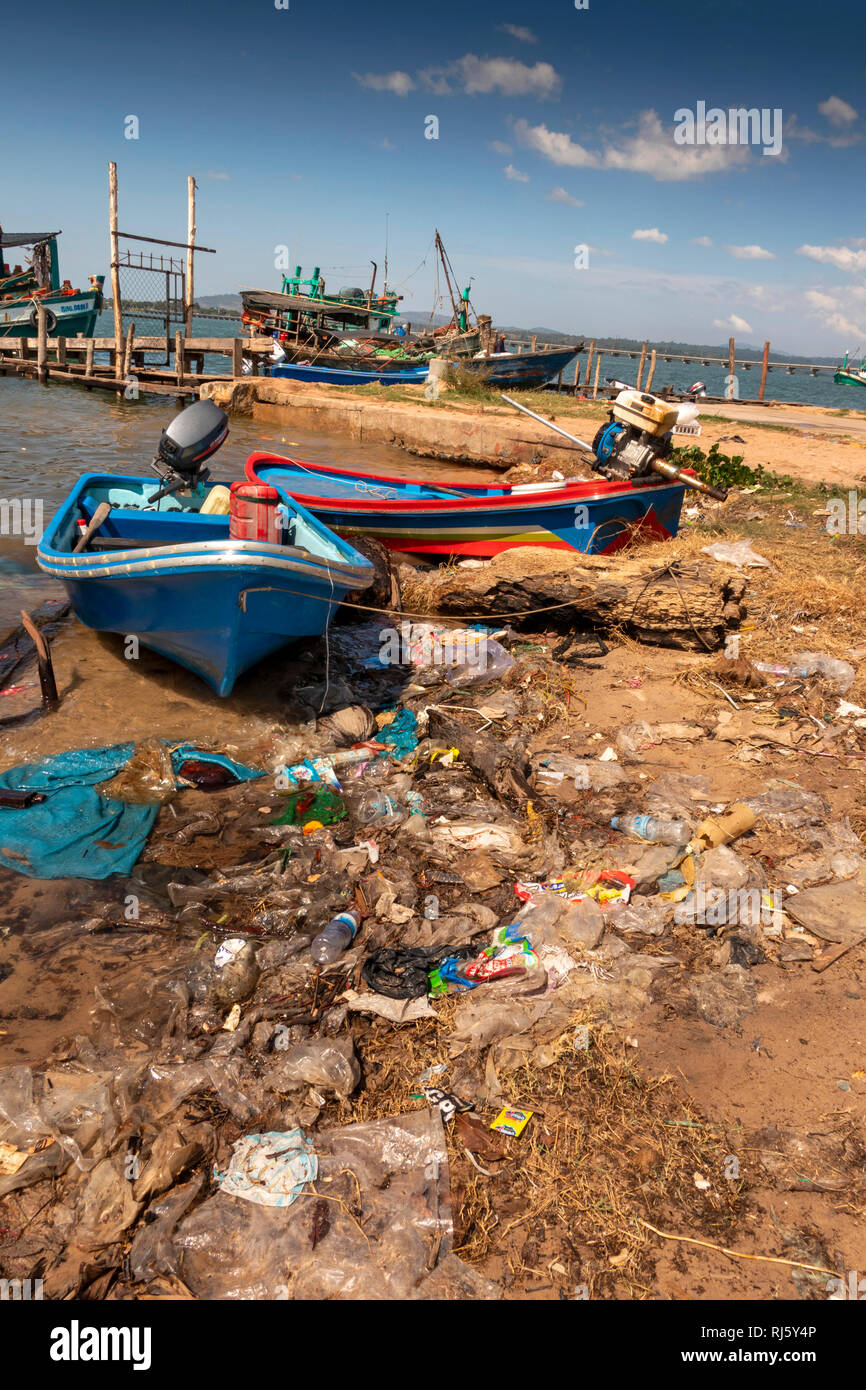 Cambodia, Preah Koh Kong, Prek Kaoh Pao river fishing boats on messy shore littered with plastic - Stock Image