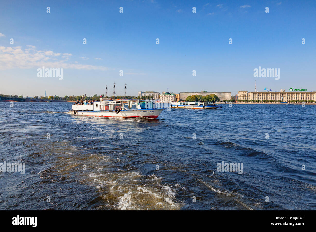 19 September 2018: St Petersburg, Russia - Tourist boats on the River Neva, on a bright and sunny autumn day. - Stock Image