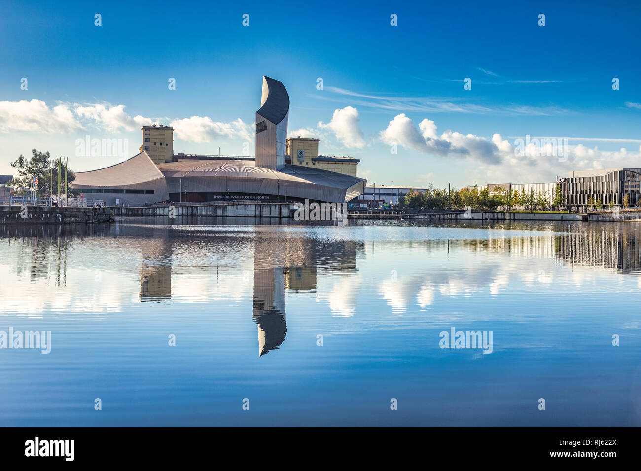 2 November 2018: Salford Quays, Manchester, UK - Imperial War Museum North, reflected in the Manchester Ship Canal, on a beautiful autumn day with... - Stock Image