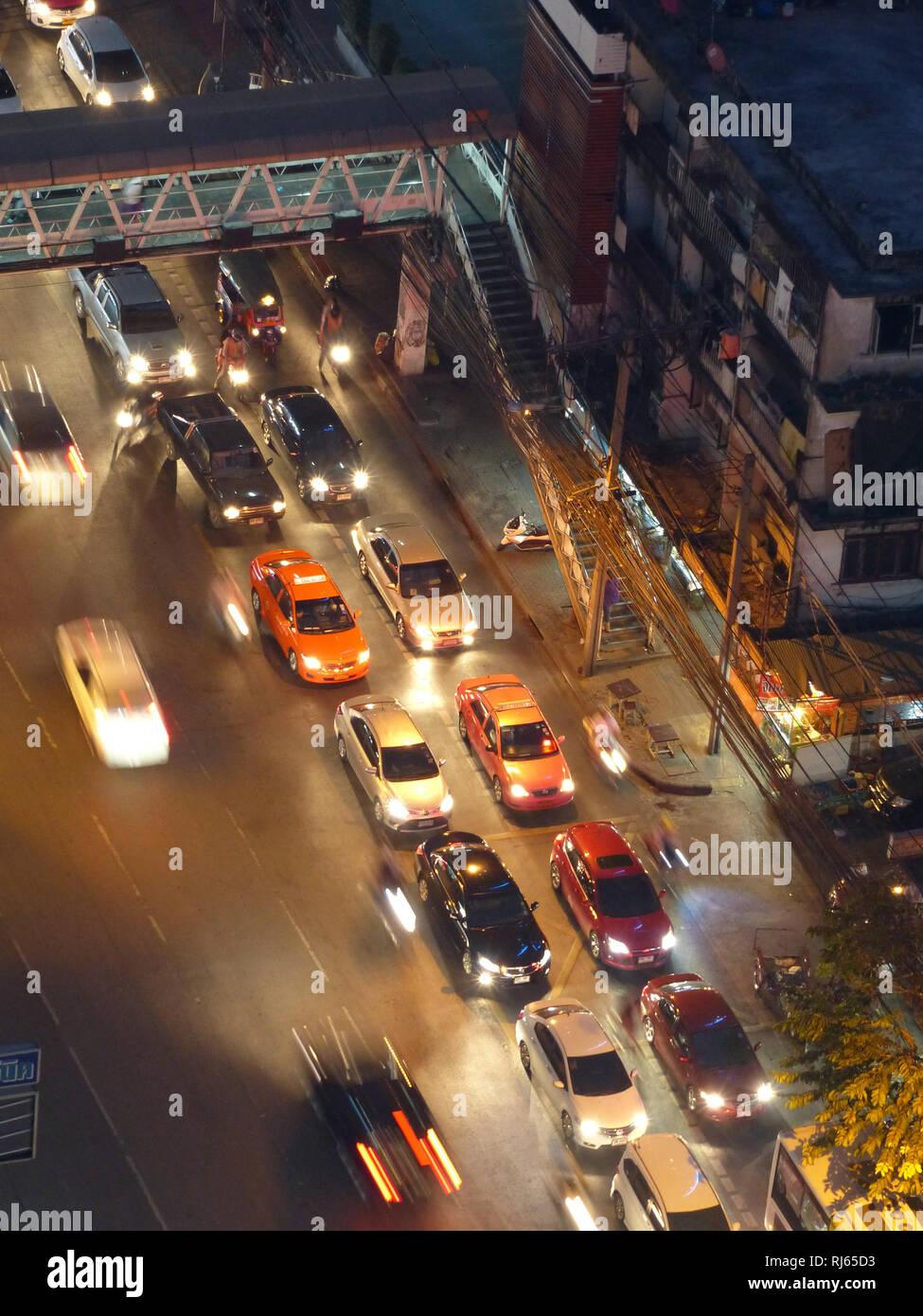 Night traffic jam in Bangkok, taxicabs - Stock Image