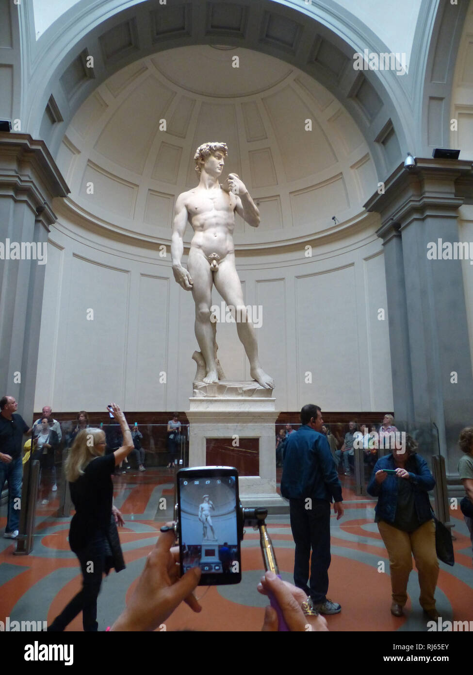 David by Michelangelo is photographed by a tourist Stock Photo