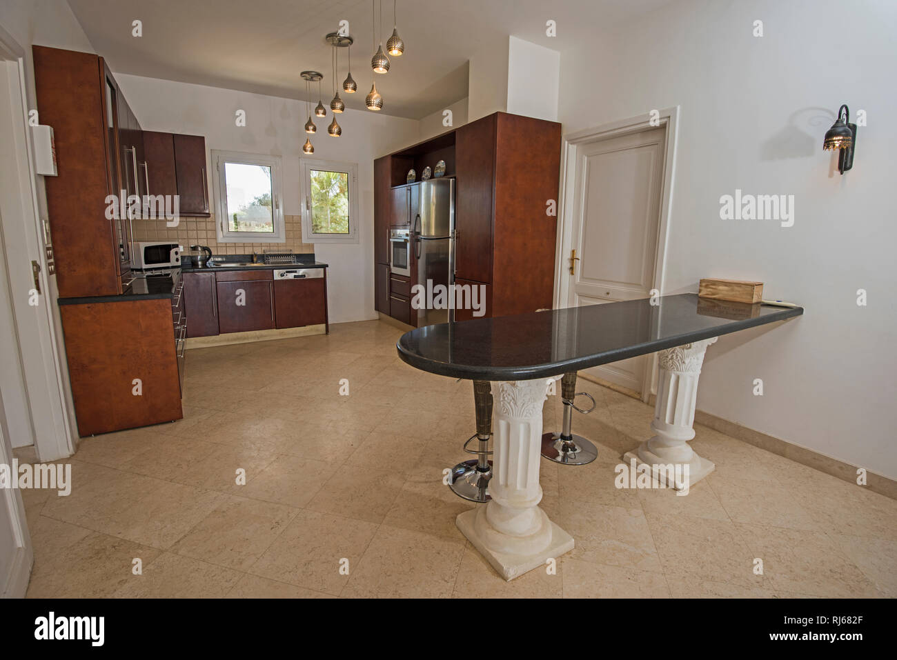Kitchen area in luxury holiday villa show home showing ...