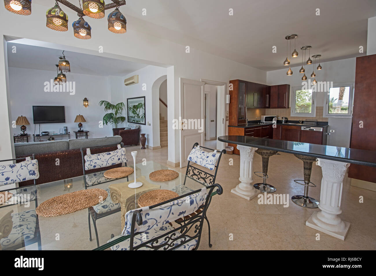 Kitchen and dining area in luxury holiday villa show home ...
