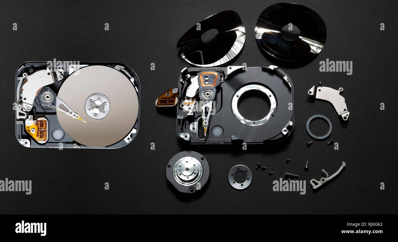 Computer hard disc before and after it is rendered safe from data theft. Stock Photo