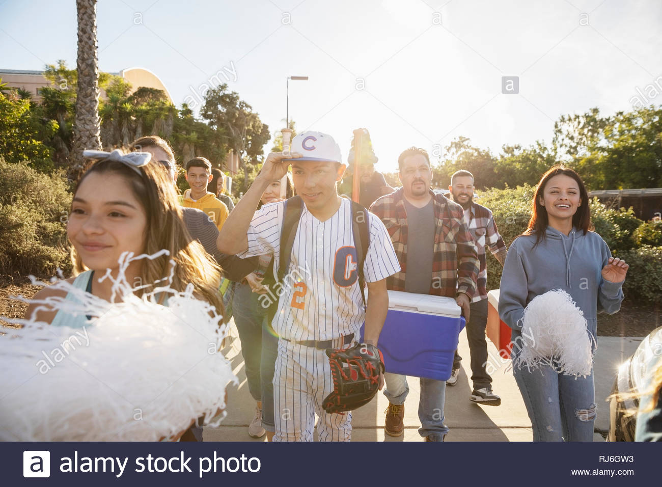 Baseball player and family arriving at game - Stock Image