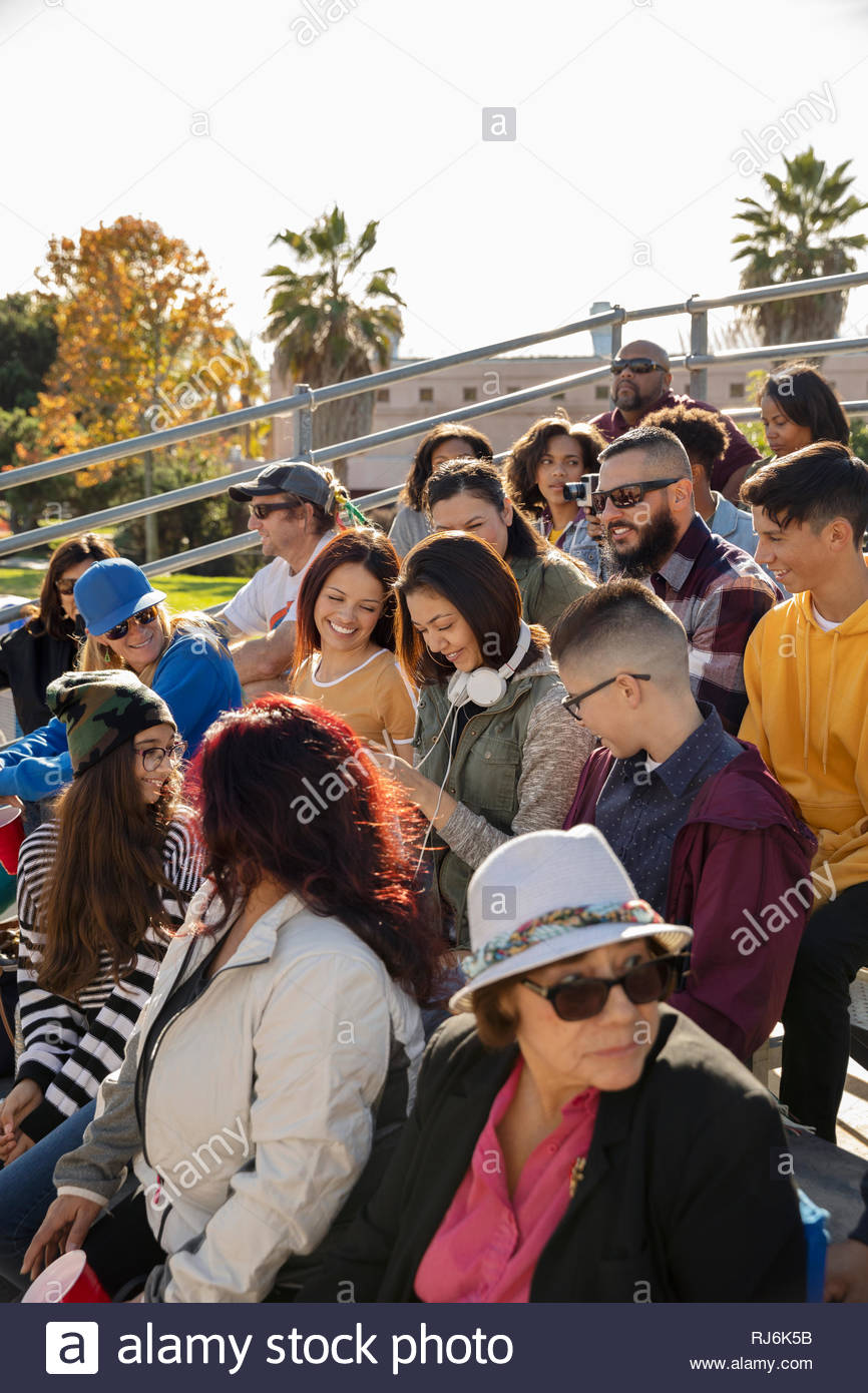 Latinx fans in bleachers at baseball game - Stock Image