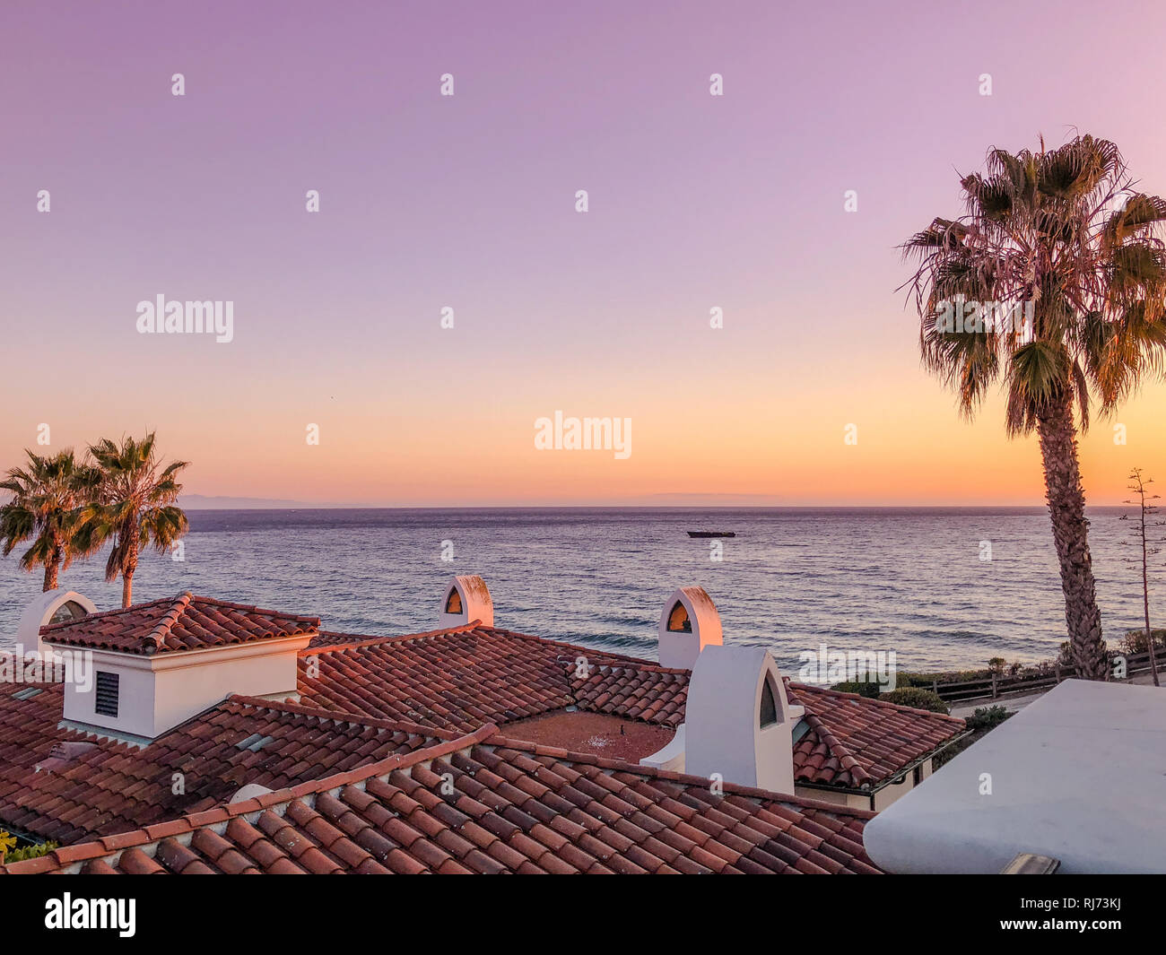 Sunset Over Pacific Ocean Near Santa Barbara Usa Rooftops And Palm Trees Stock Photo Alamy