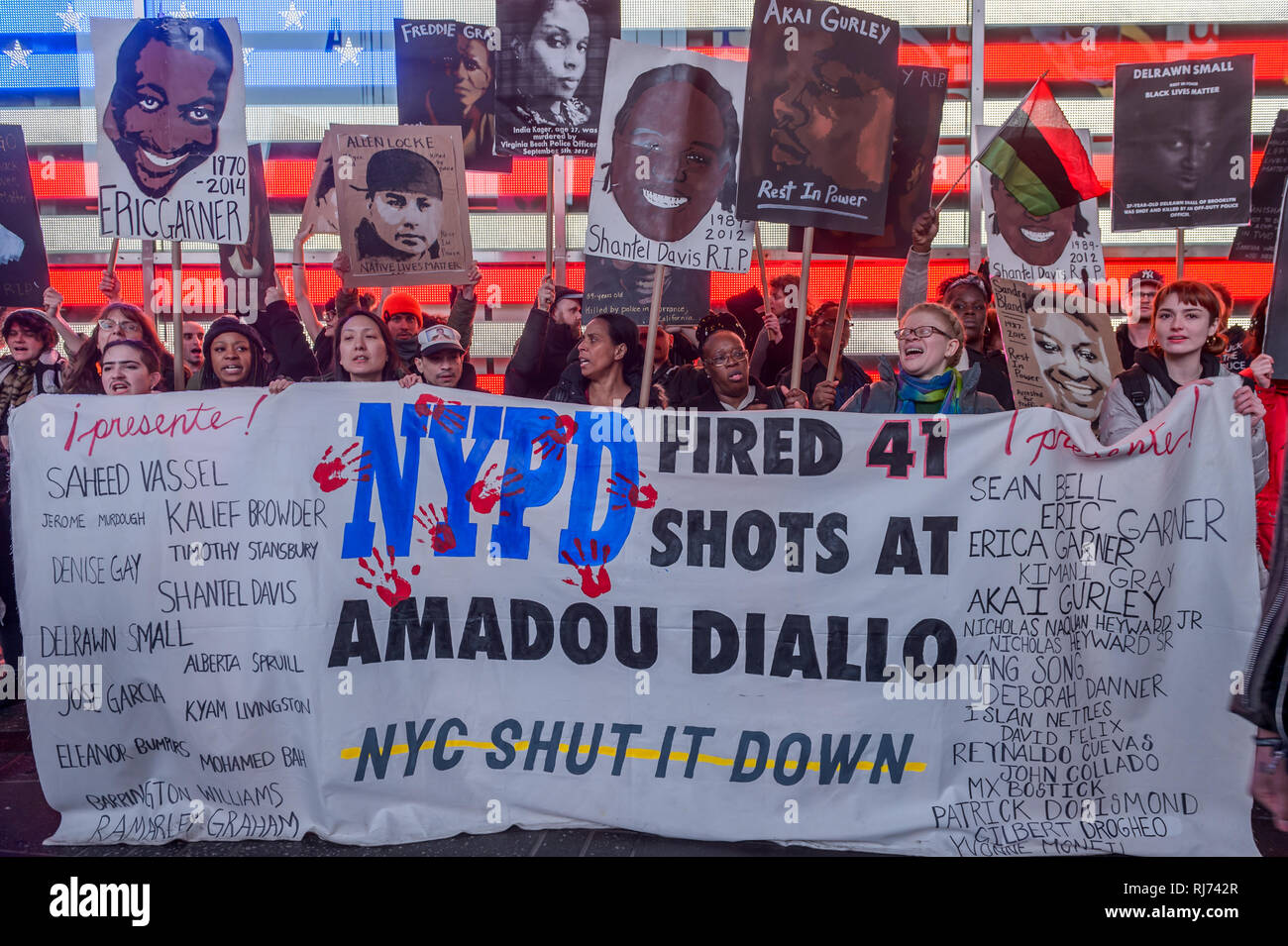 Members of the activist group NYC Shut It Down gathered at Grand Central and took the streets marching to Times Square on February 4, 2019, to remember the 20 year anniversary of the murder of Amadou Diallo in the Bronx, shot 41 times by the NYPD. During the march, the group also displayed portraits of other victims of police brutality. (Photo by Erik McGregor / Pacific Press) - Stock Image
