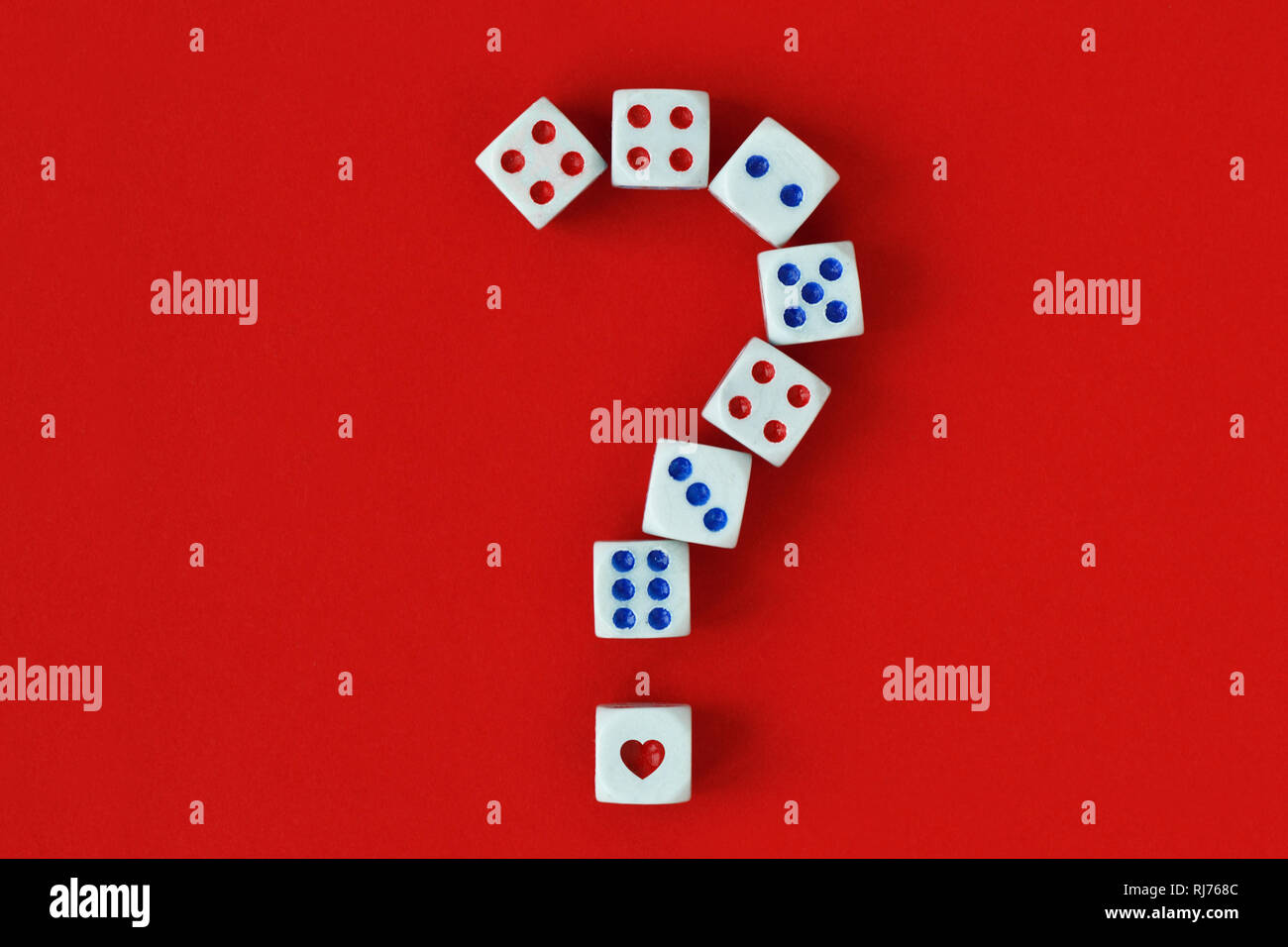 Question mark made of dices and heart on red background - Concept of risk and chance on love - Stock Image