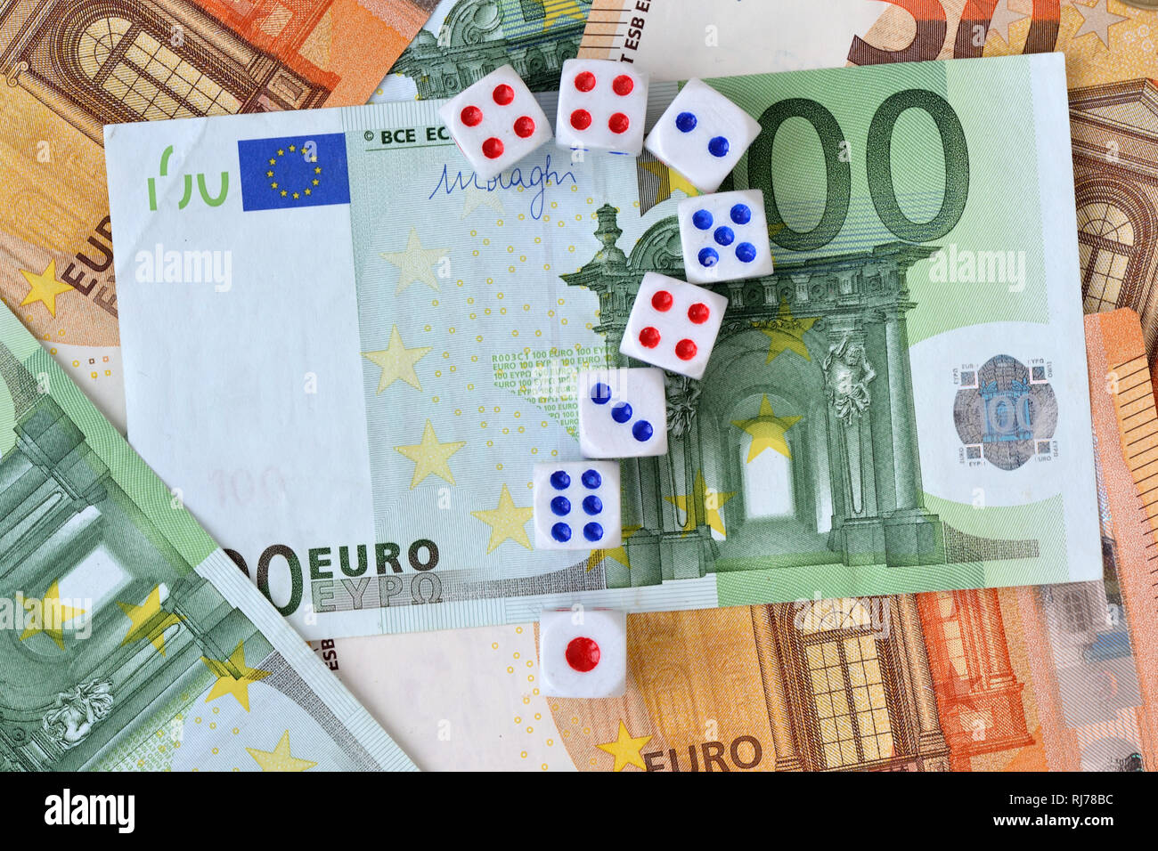 Question mark made of dices on euro money background - Concept of risky investments and gamble - Stock Image