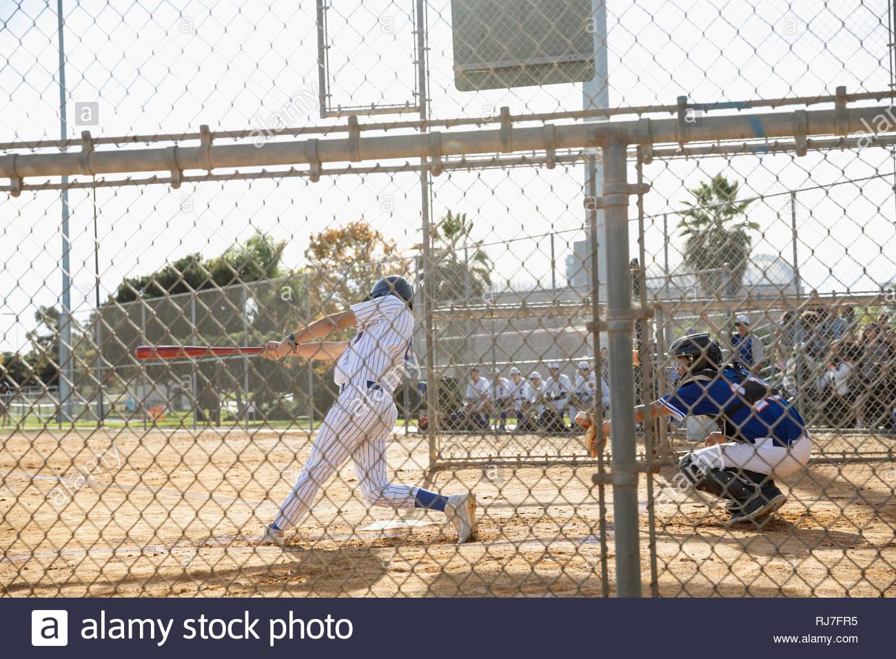 Baseball player at bat on sunny field Stock Photo