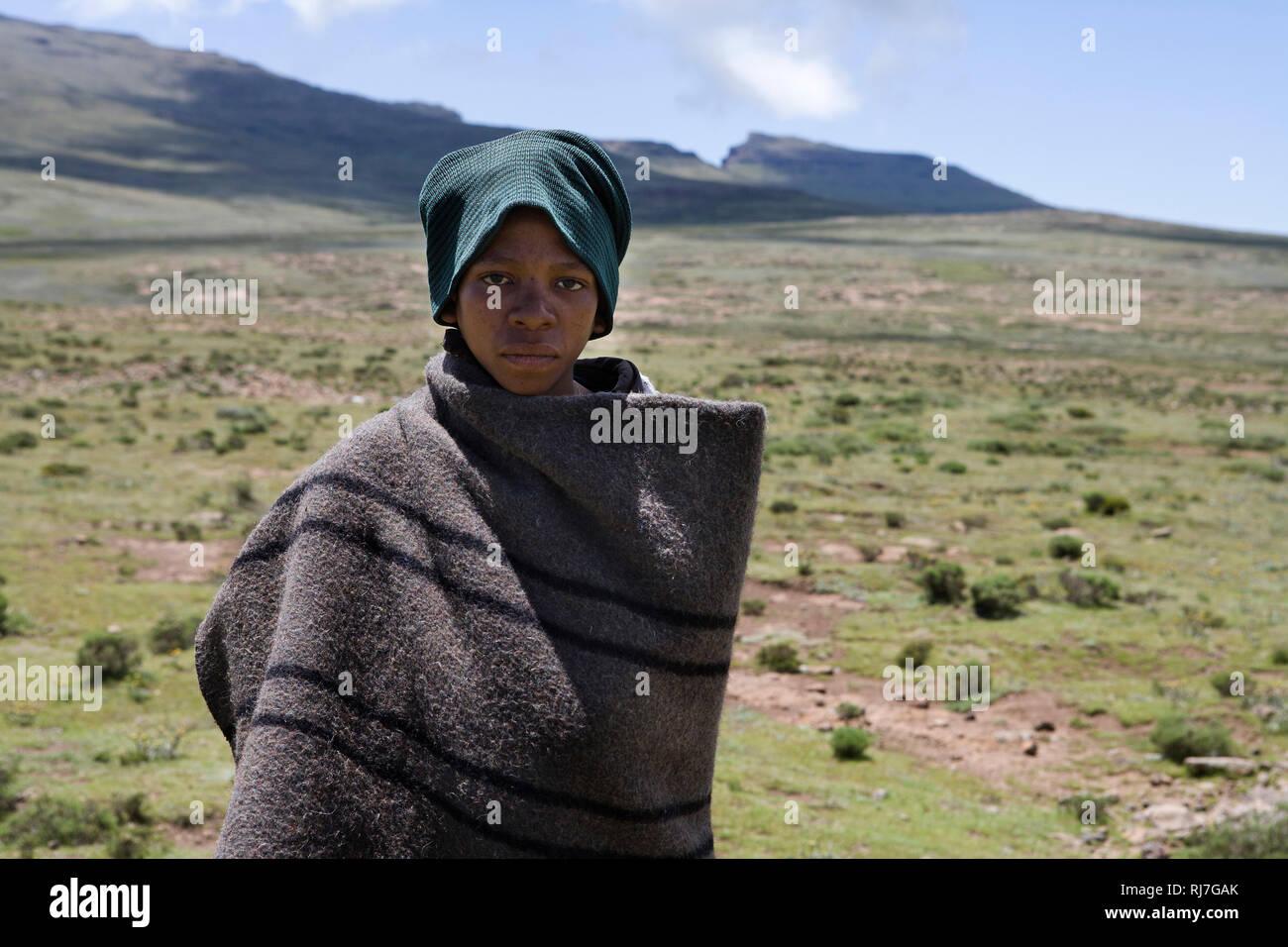 Hirtenjunge in den Bergen von Lesotho - Stock Image