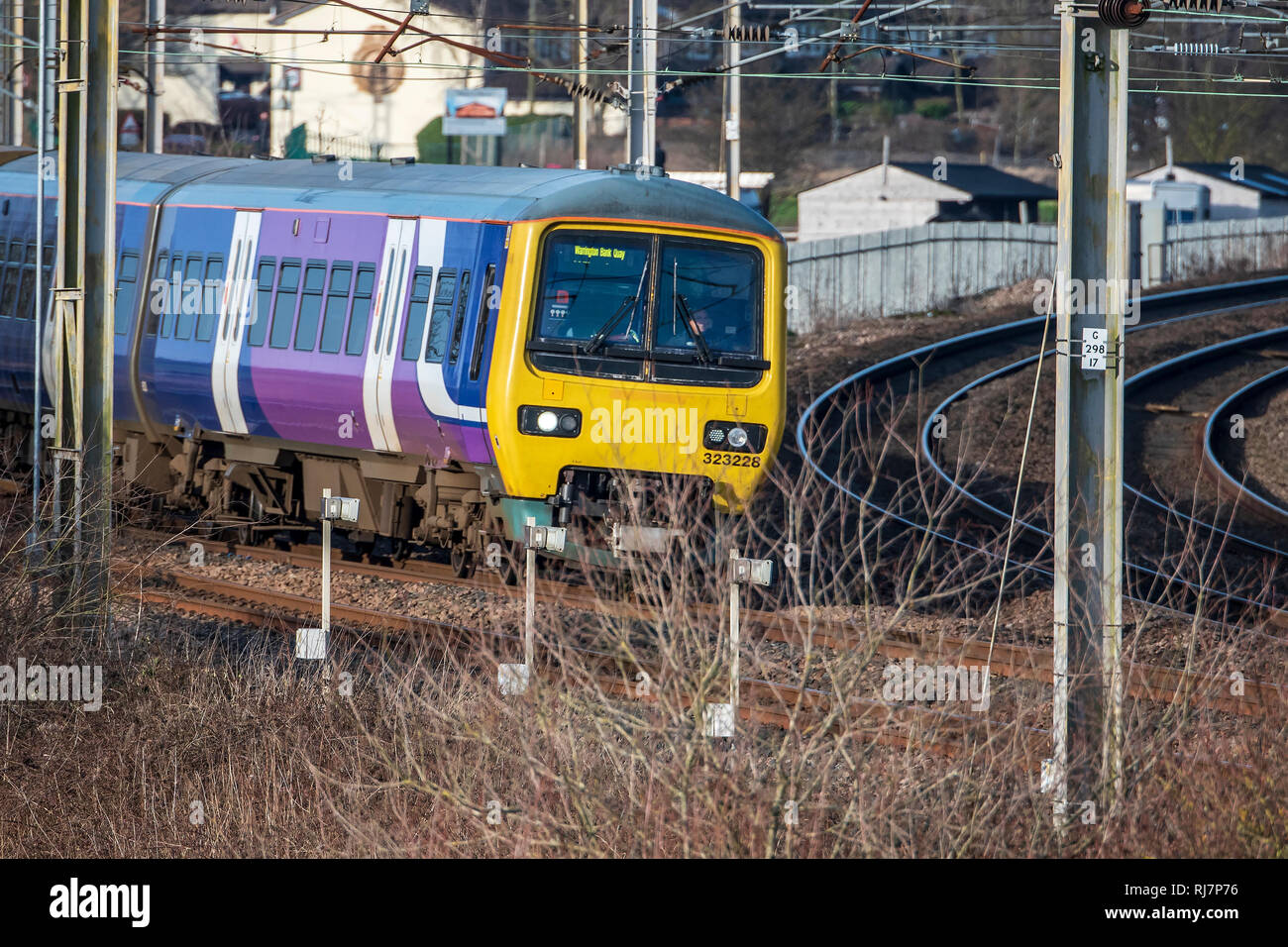 British Rail Class 323 electric multiple unit train. Seen at Winwick junction on the West Coast Main Line. - Stock Image