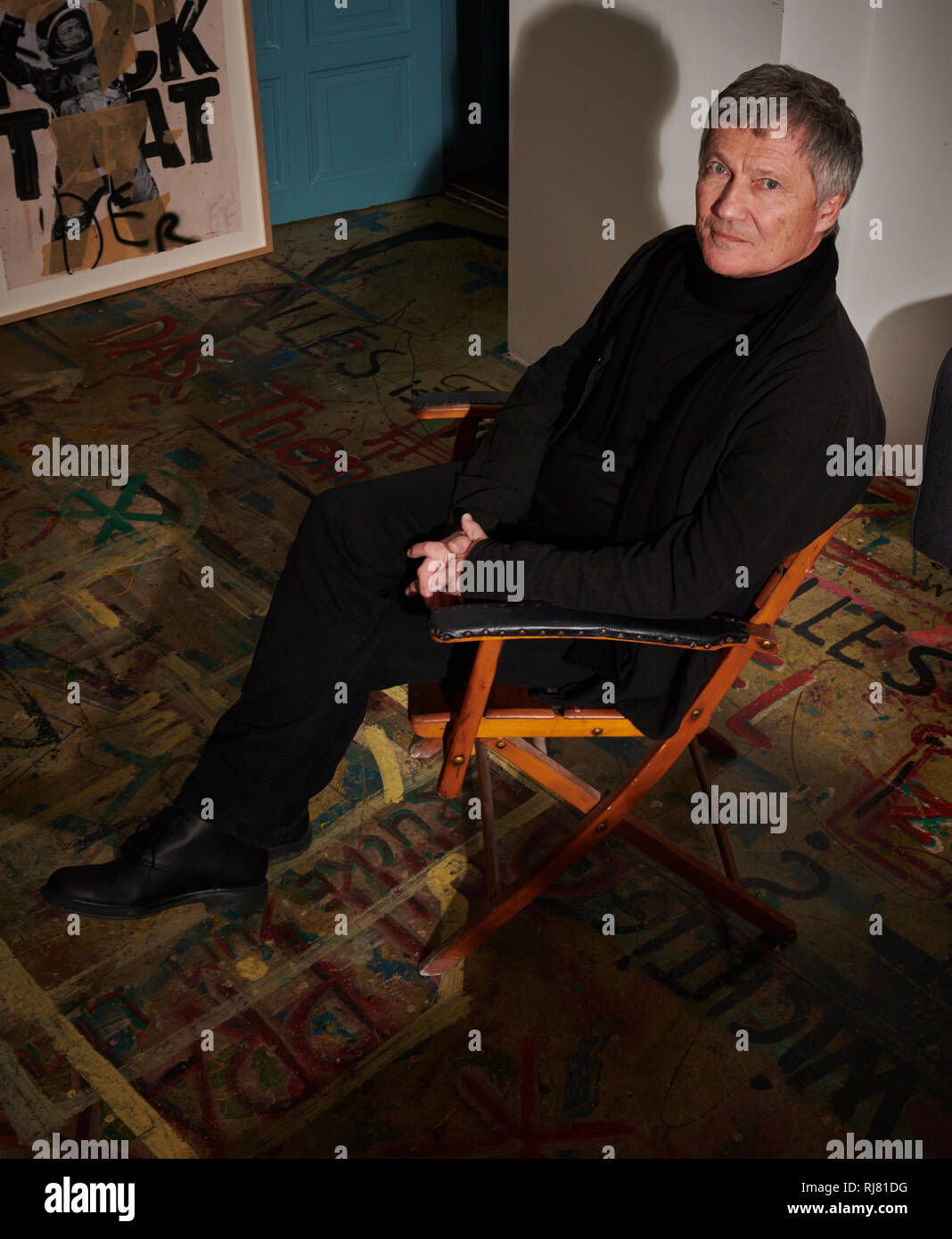 17 January 2019, Berlin: The musician Michael Rother sits on a chair in his record label Grönland Office. His new album 'Solo' will be released on 22.02.2019. Photo: Annette Riedl/dpa - Stock Image