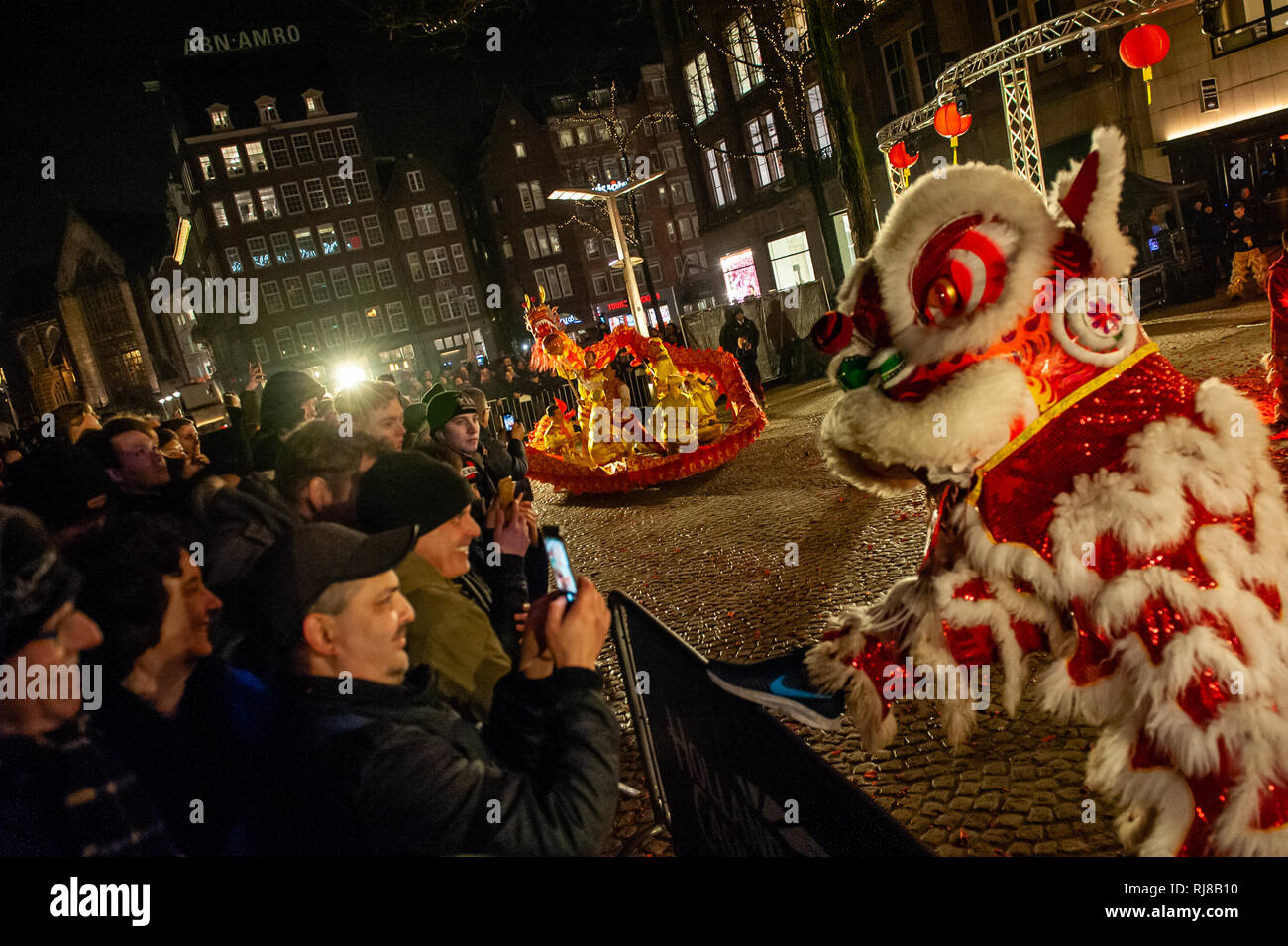 A Chinese dragon is seen interacting with some of the public