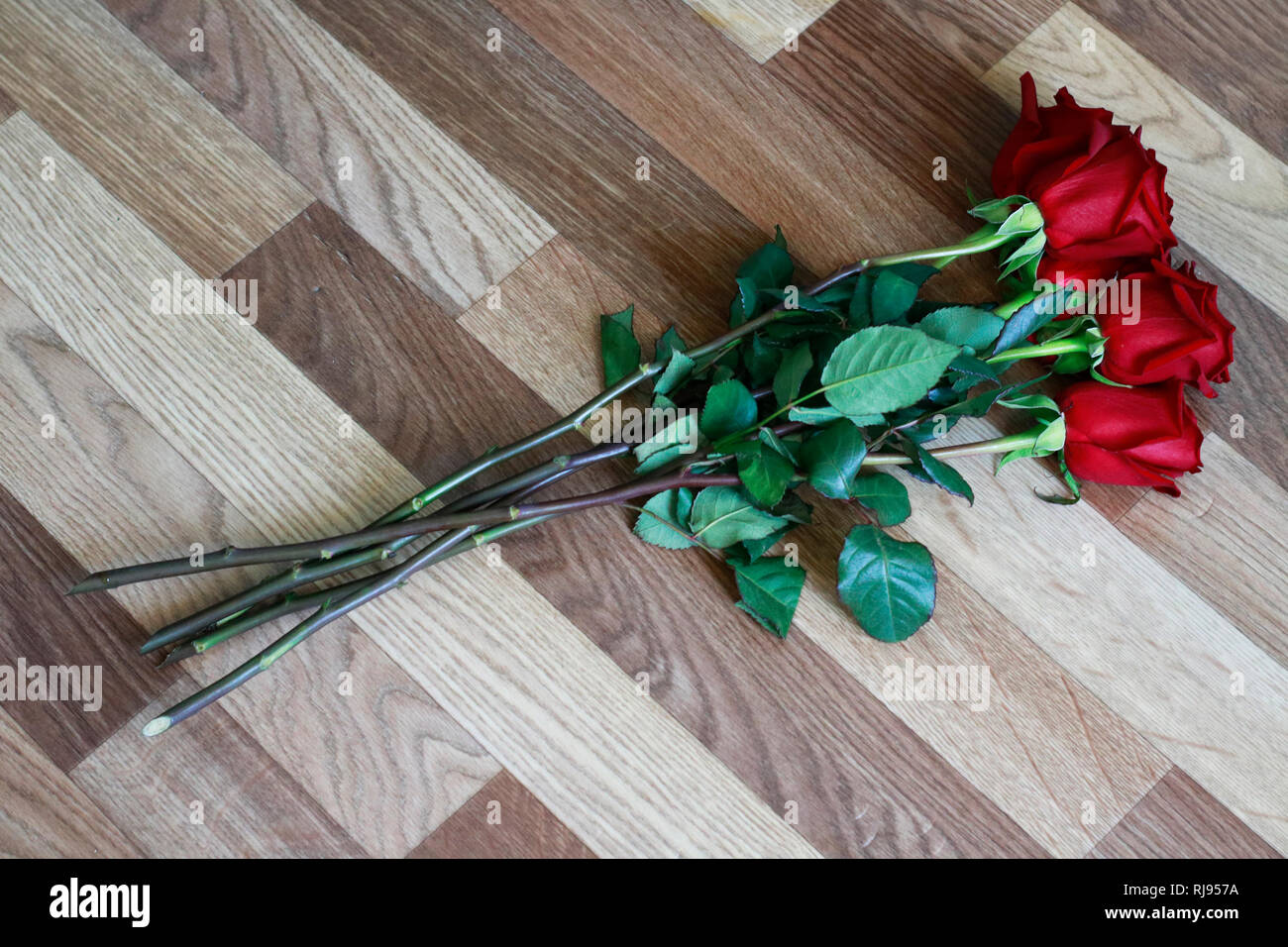 e721de040abeee Top View of Dark Red Roses Bunch on Wooden Floor. Close Up. Happy Valentine  Day