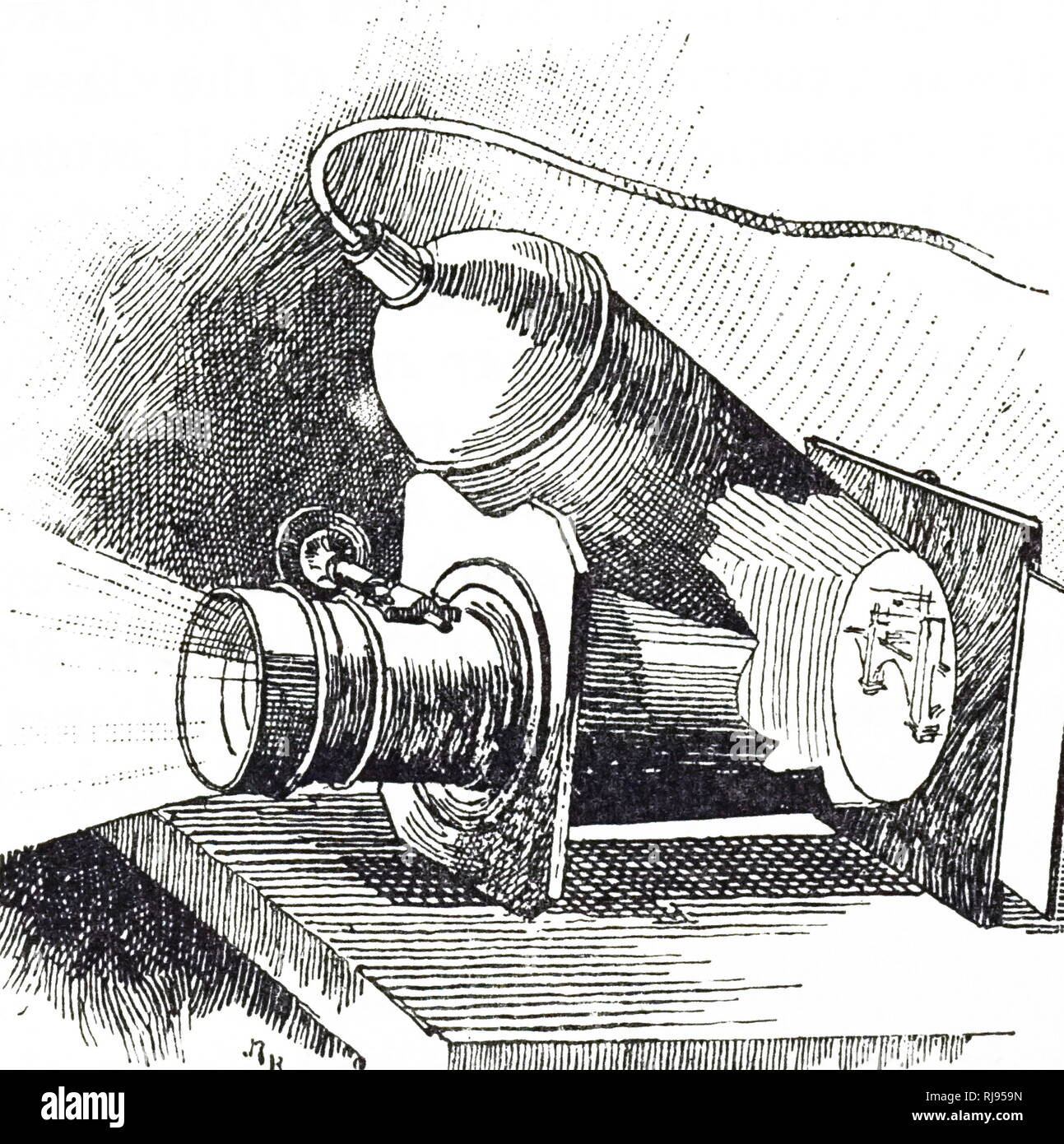 An engraving depicting Trouve's Auxanoscope for projecting medals, drawings and photographs onto a screen. The light was an incandescent electric lamp powered by four bichromate cells. Gustave Trouve (1839-1902) a French electrical engineer and inventor. Dated 19th century - Stock Image