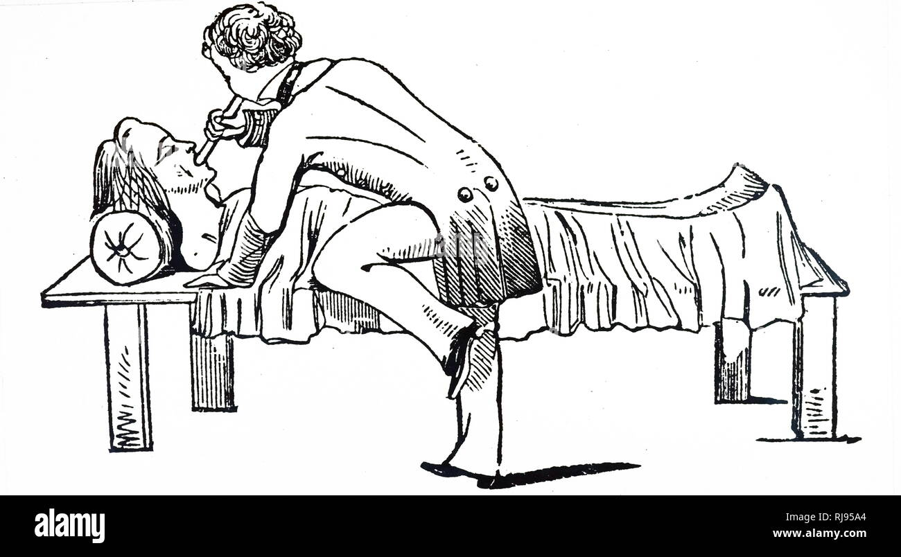 An engraving depicting early artificial respiration: using a tube to blow air into the lungs of a victim of asphyxia: applied in cases of drowning, suffocation, narcosis, electric shock, etc. Dated 19th century - Stock Image