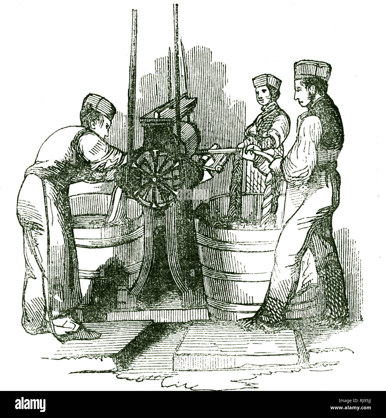 An engraving depicting the production of the worsted using a warp-scouring. Dated 19th century - Stock Image