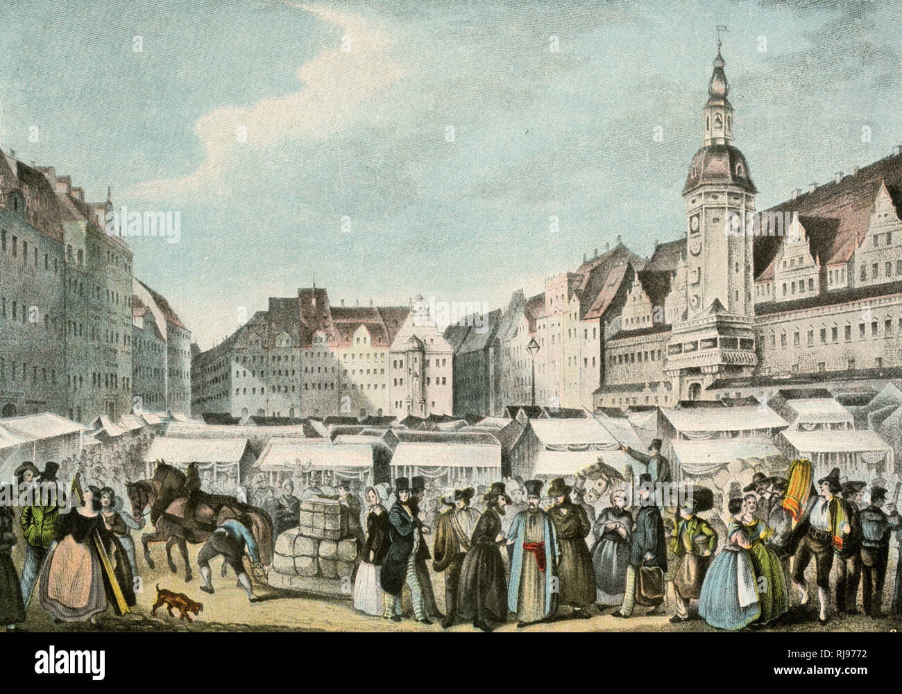 A busy scene at Leipzig fair as people mill around the stalls. Stock Photo