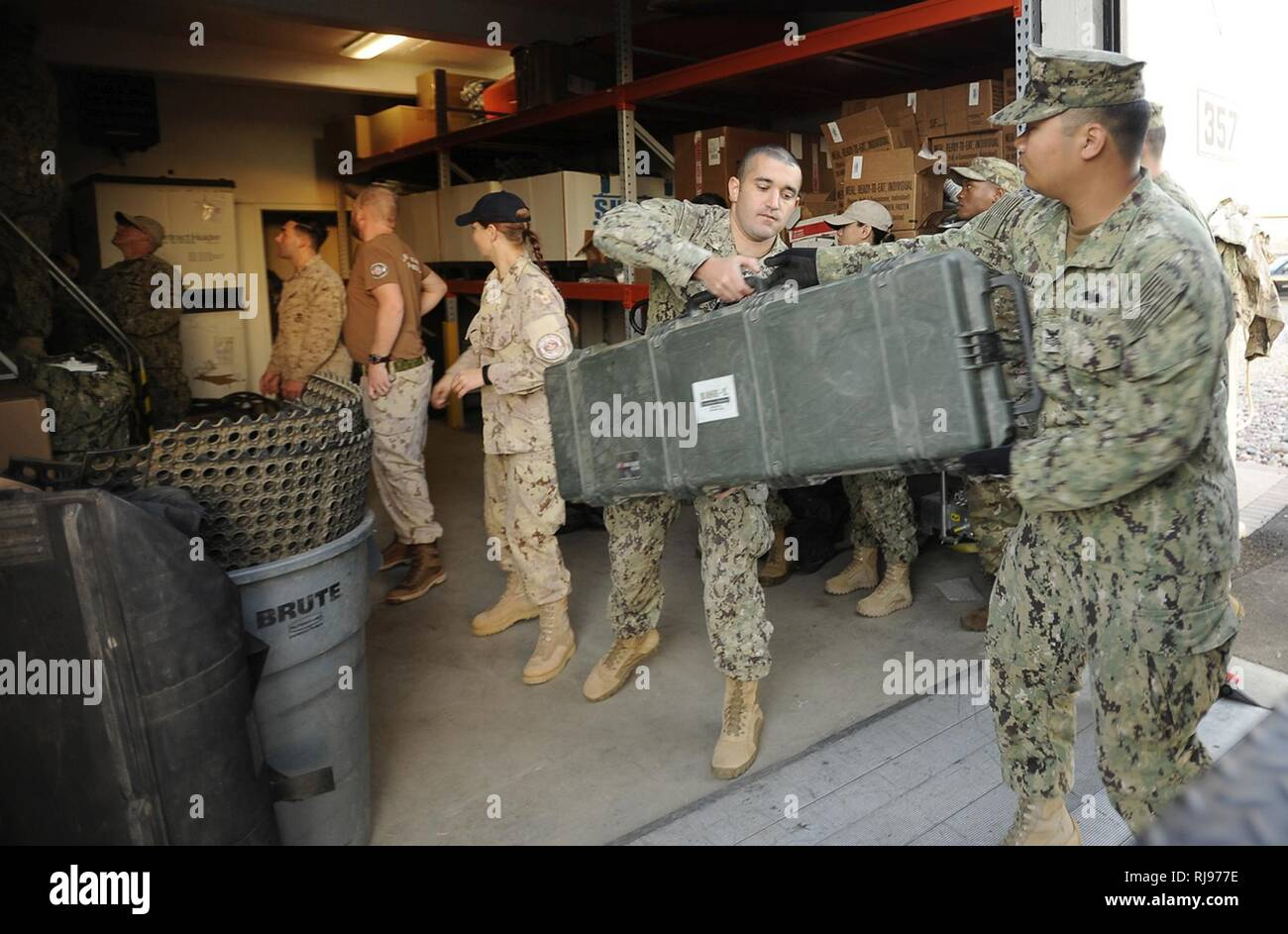 Sailors and Marines load provisions in preparation for
