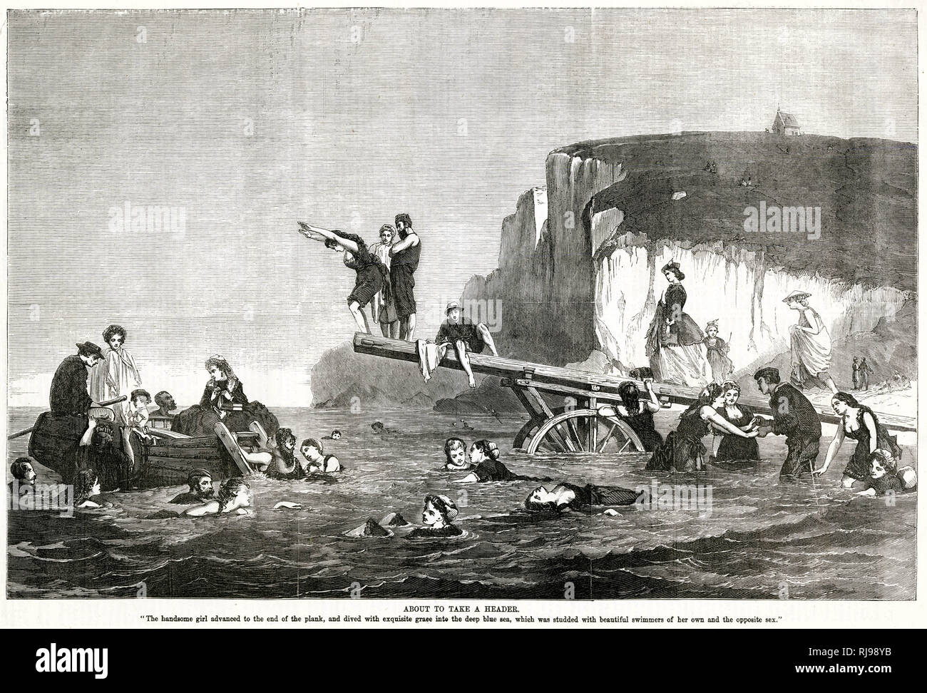 Mixed bathing and plunging from a wheeled diving board which can be moved as the tides ebb and flow Stock Photo