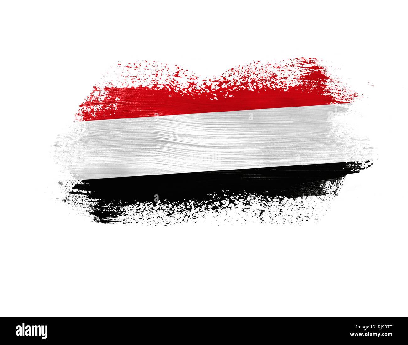 brush painted flag of Yemen isolated on white background. - Stock Image