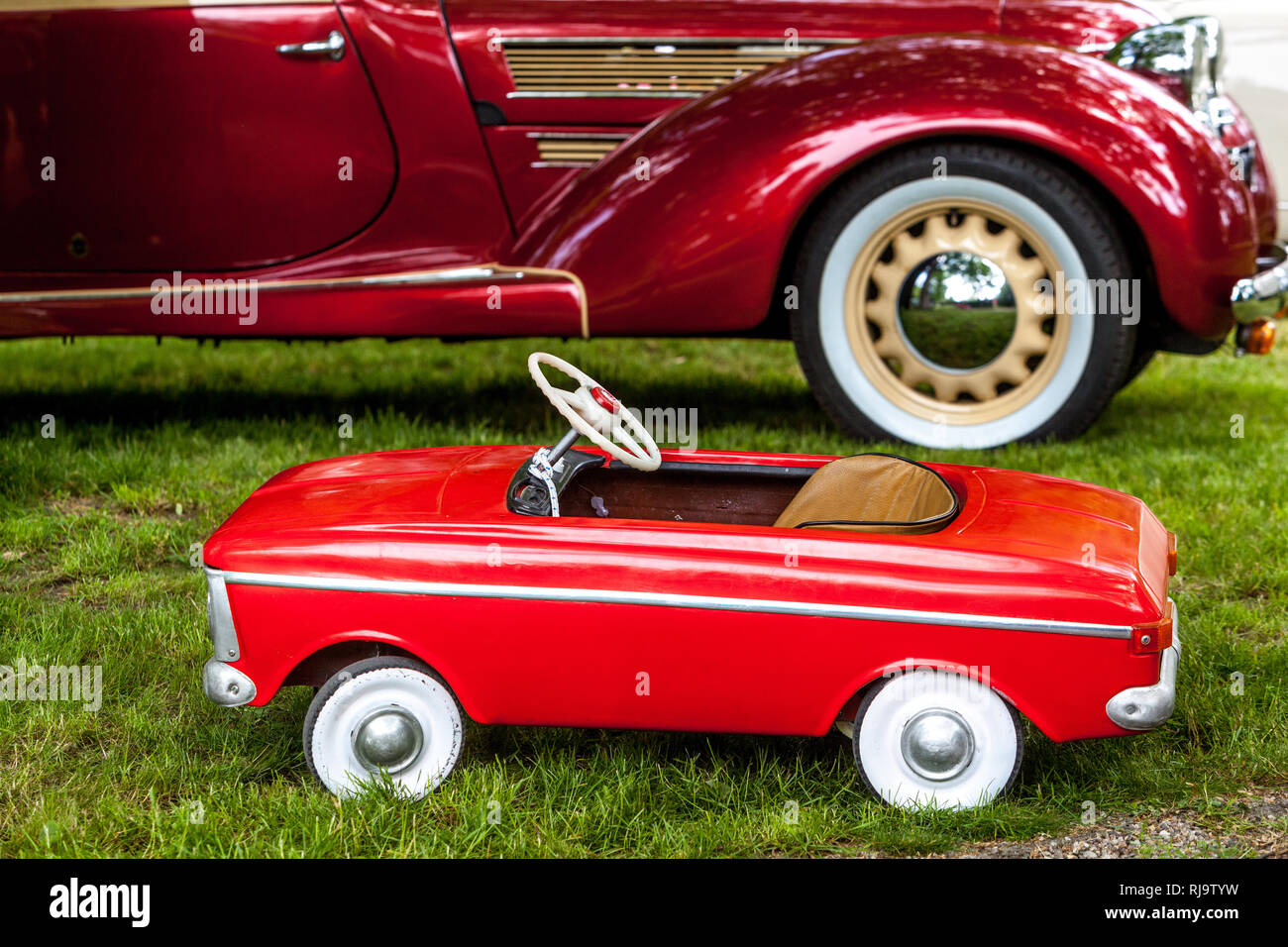 Two veterans car, pedal toy car  and, Aero 50 cabrio Sodomka 1938 - Stock Image