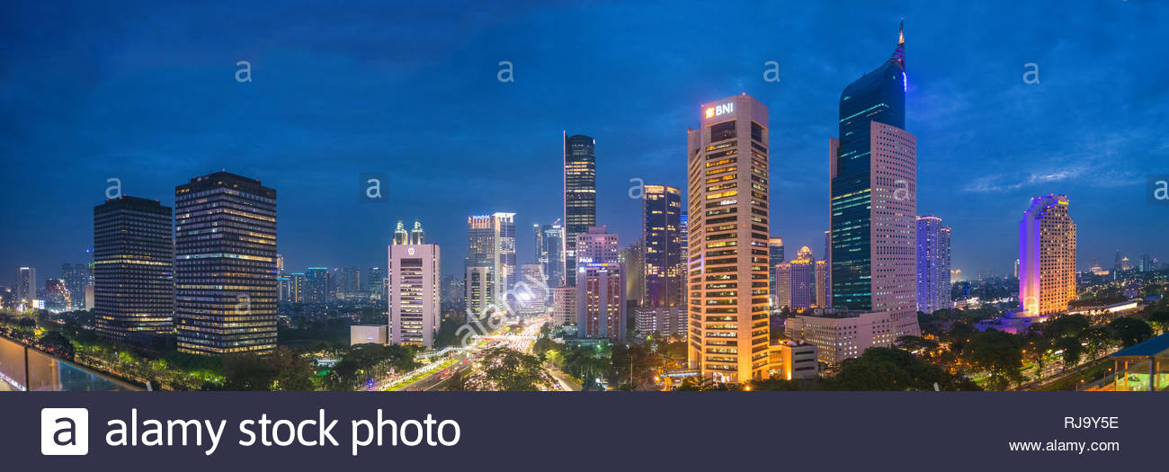 Aerial view of Jakarta's Central Business District (Kuningan and Sudirman) at twilight (blue hour). Jakarta cityscape at sunset. - Stock Image
