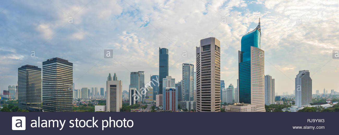 Aerial view of Jakarta's Central Business District (Sudirman and Kuningan) at a cloudy afternoon. Widescreen photo. Jakarta cityscape. - Stock Image
