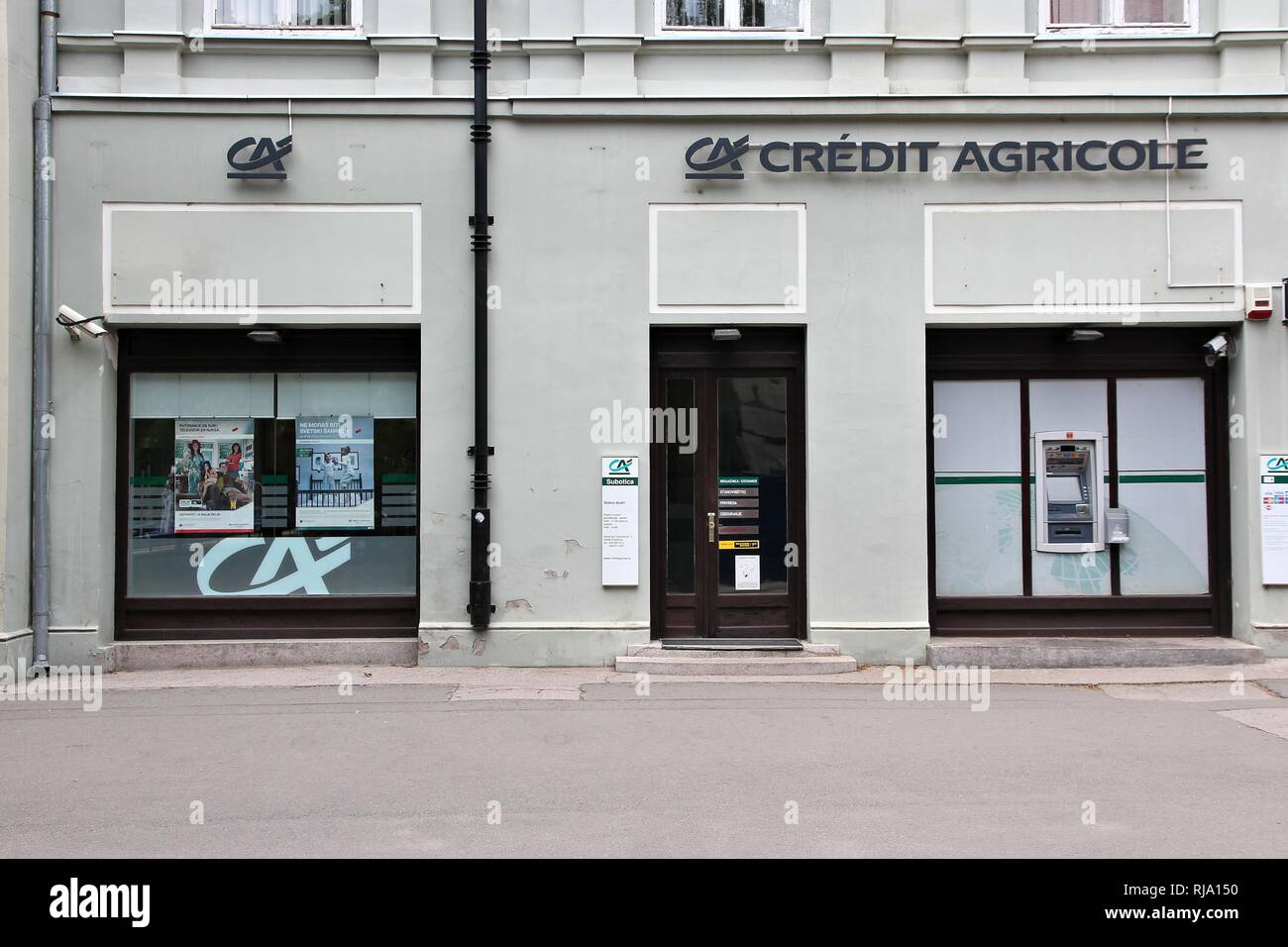 SUBOTICA, SERBIA - AUGUST 12: Credit Agricole bank branch on August 12, 2012 in Subotica, Serbia. CA is the largest retail banking group in France, an - Stock Image