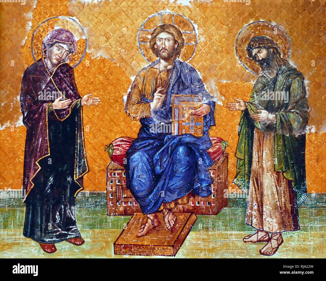 Virgin Mary; Jesus Christ and John the Baptist, depicted on an 13th Century, Byzantine mosaic; Hagia Sofia, Istanbul, Turkey. Hagia Sophia is a former Greek Orthodox, Christian church, later an Ottoman imperial mosque and now a museum. Built in 537 AD at the beginning of the Middle Ages, it was famous in particular for its massive dome. It was the world's largest building and an engineering marvel of its time. Stock Photo