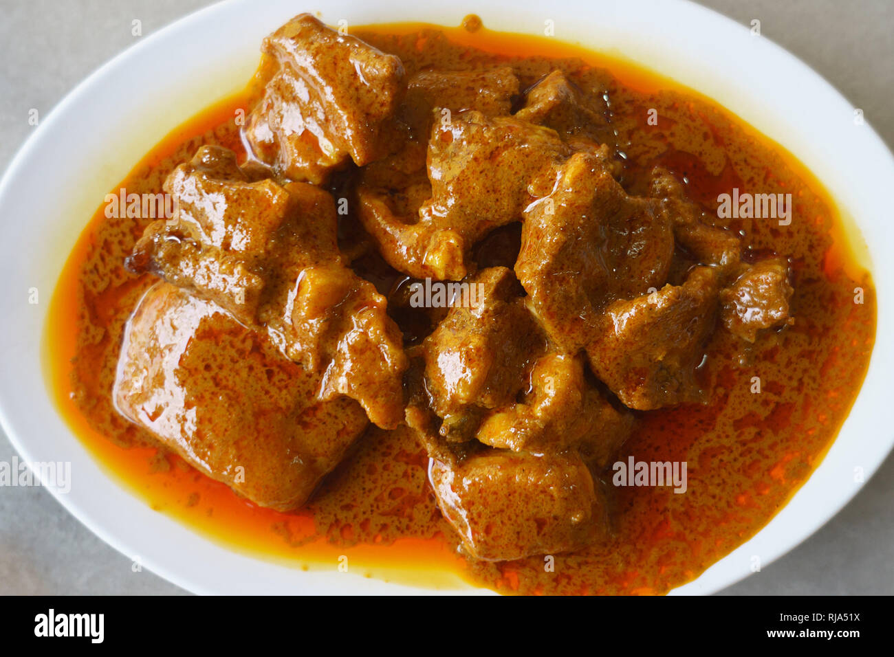 Malaysian street food a delicious Indian mutton curry on table setup. Stock Photo