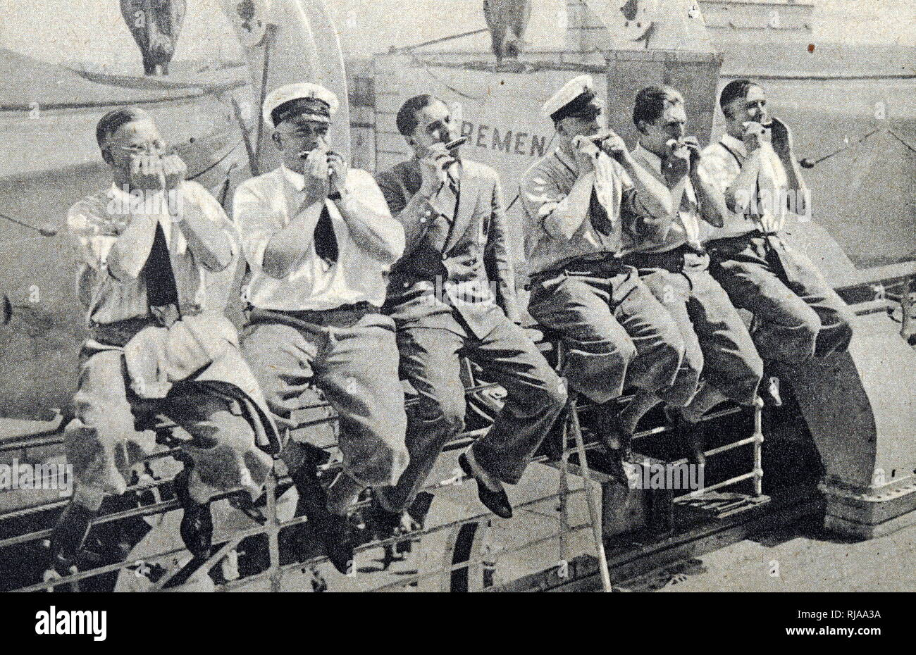 The German water polo team for the 1932 Los Angeles Olympics sat playing music together. Dated 20th Century - Stock Image