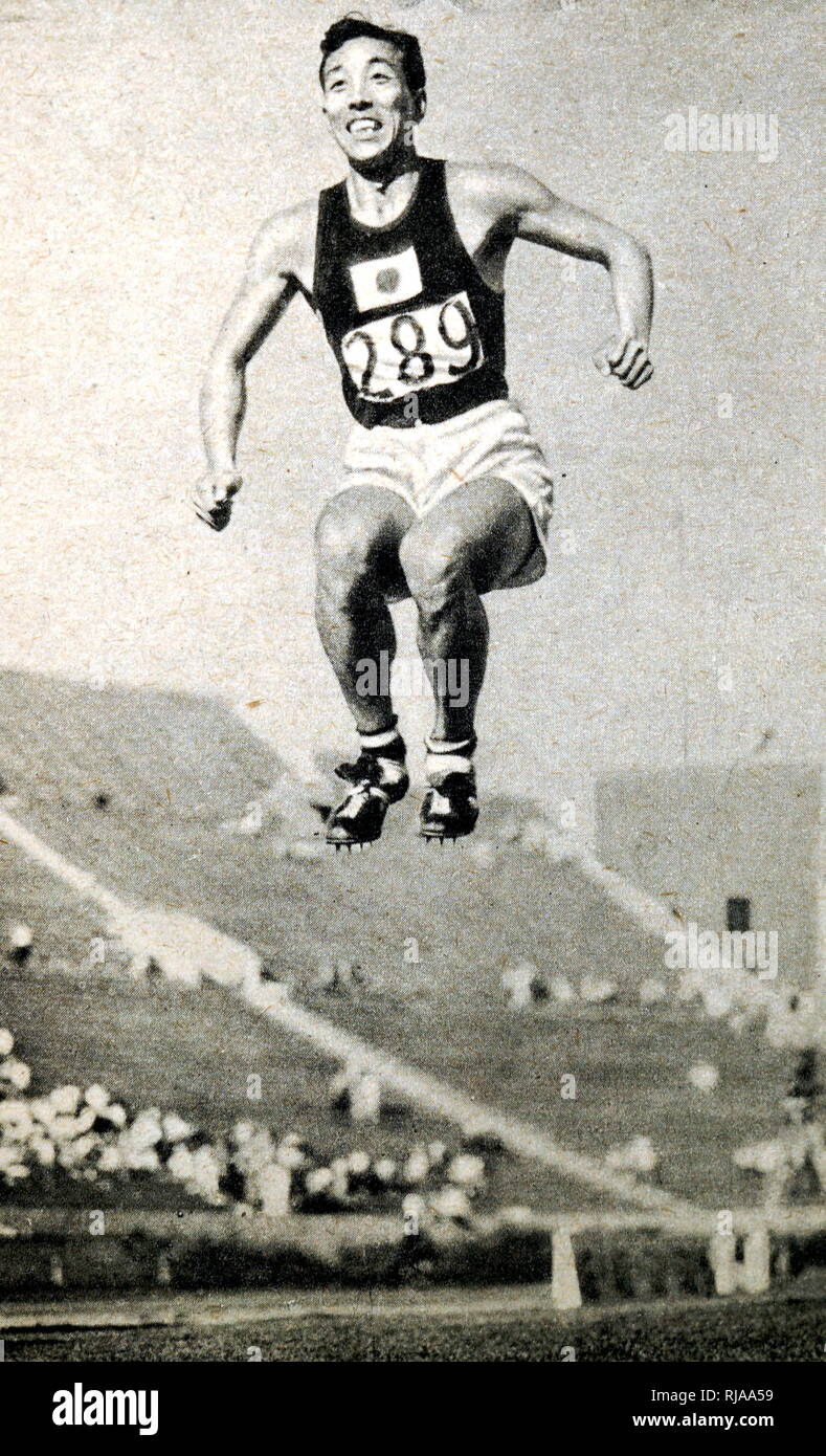 Photograph of Chuhei Nambu from Japan competing in the Long Jump during the 1932 Olympic games. He finished third in the Long jump that year, however he made a new world record in the Triple Jump, jumping 15.72 meters. - Stock Image