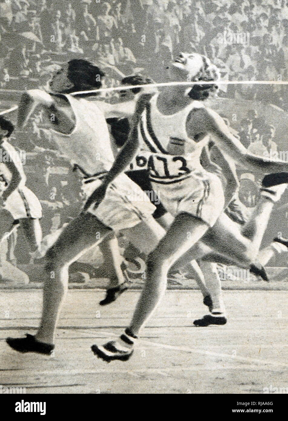 Photograph of Mildred Ella 'Babe' Didrikson Zaharias (1911 - 1956)  winning the 80m Hurdles at the 1932 Olympic games. Babe gained world fame in track and field and All-American status in basketball. - Stock Image