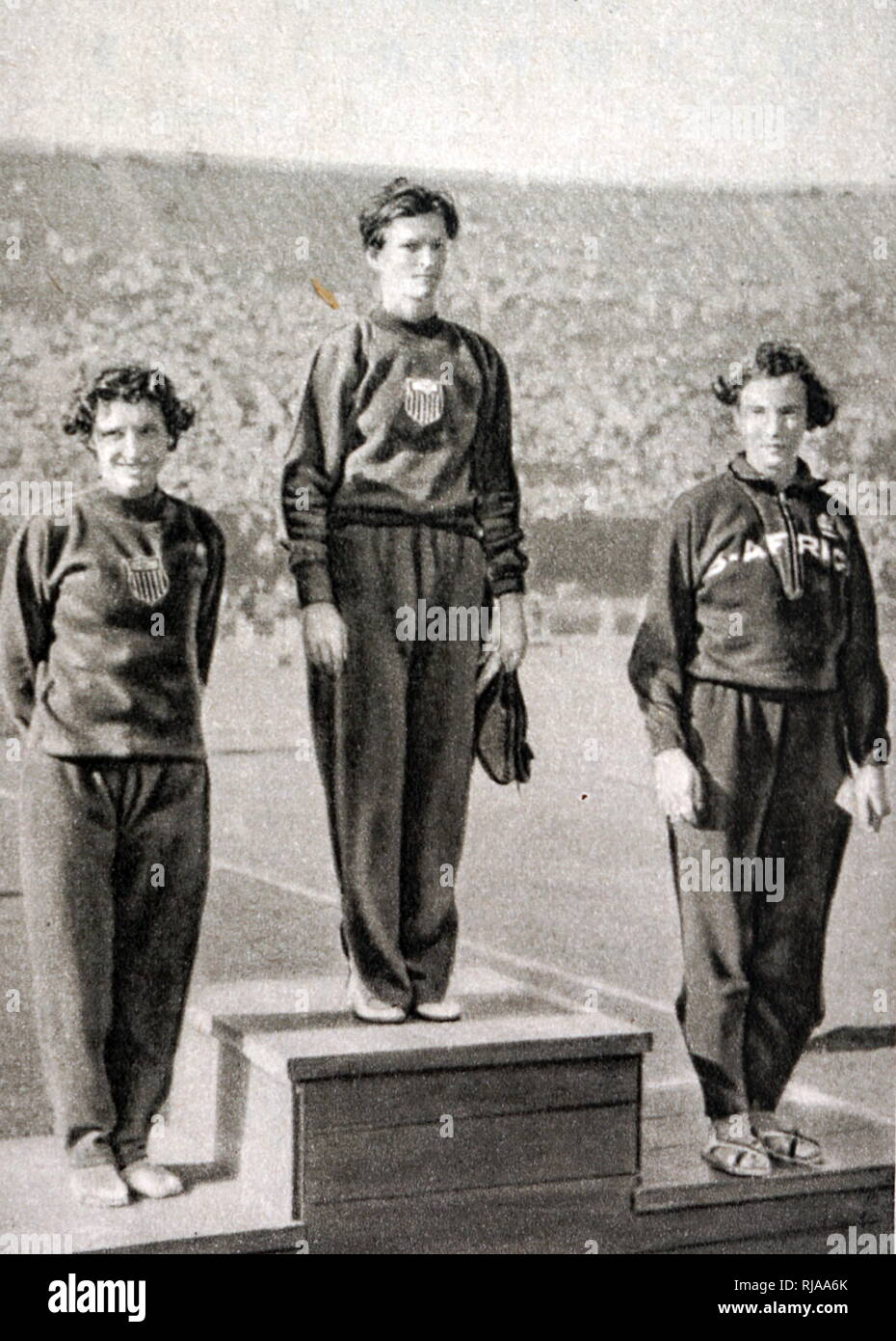 80m Hurdles podium at the 1932 Olympic games.  Mildred Ella 'Babe' Didrikson Zaharias (1911 - 1956) took gold for the USA. Evelyne Ruth Hall (1909 - 1993) took silver for the USA. Marjorie Rees Clark (1909 - 1993) took bronze for South Africa. - Stock Image