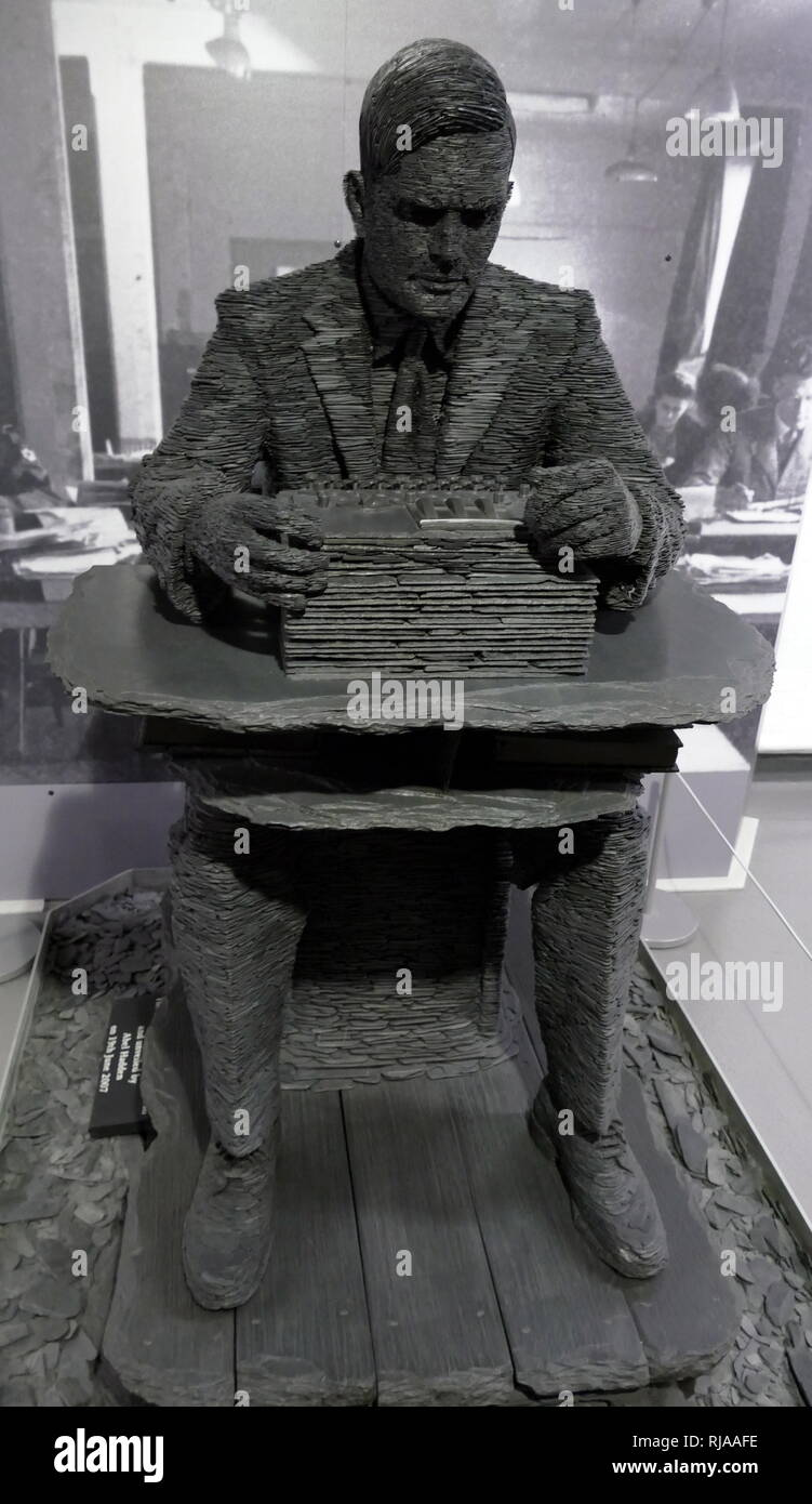 Alan Turing (1912 – 1954), English computer scientist, mathematician, logician, cryptanalyst, philosopher, theoretical biologist. Sculpture in slate by Stephen Kettle (born 12 July 1966). This life size statue of Alan Turing is at the Bletchley Park Museum - Stock Image