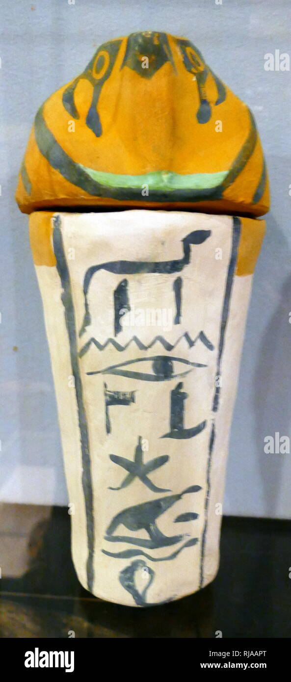 replica of a canopic jar used by the ancient Egyptians during the mummification process to store and preserve the viscera of their owner for the afterlife. - Stock Image