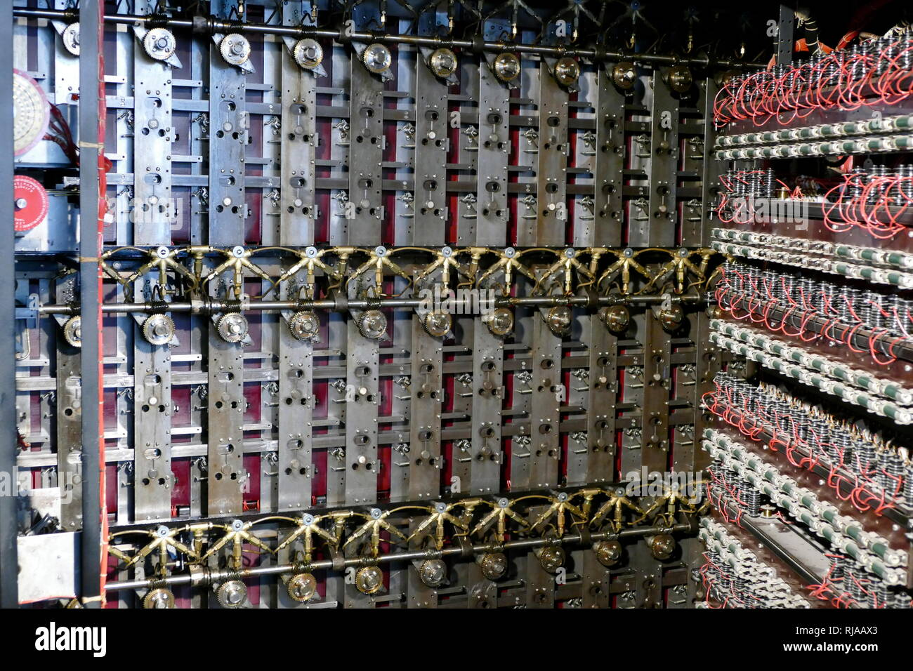 Rear view of the rebuilt Bombe at Bletchley Park. This shows the patch panels and 26-way cables used to wire up the 'menus'. It includes the 'diagonal boards' which, despite their name, are physically rectangular. The bombe was an electro-mechanical device used by British cryptologists to help decipher German Enigma-machine-encrypted secret messages during World War II. The initial design of the bombe was produced in 1939 at the UK Government Code and Cypher School (GC&CS) at Bletchley Park by Alan Turing, with an important refinement devised in 1940 by Gordon Welchman Stock Photo