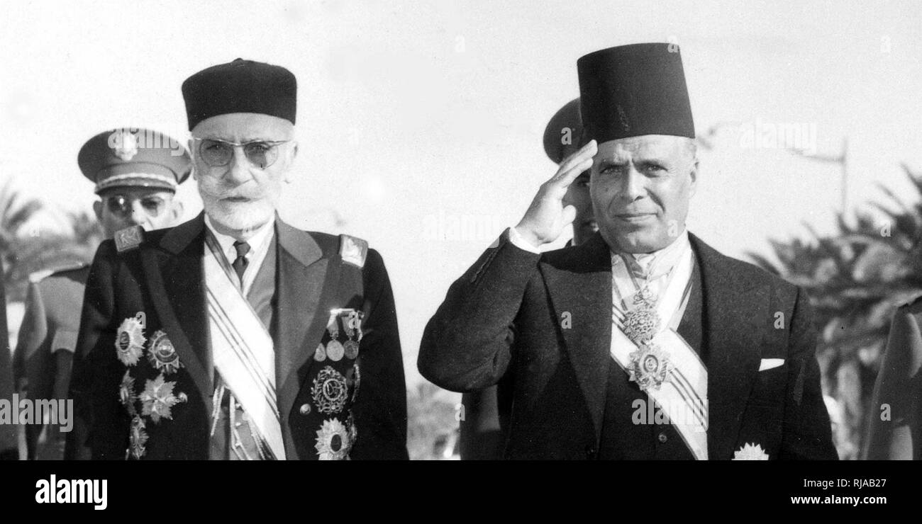 Muhammad VIII al-Amin (left) last Bey (King) of Tunisia with Habib Bourguiba in 1957. Habib Ben Ali Bourguiba (1903 – 2000); Tunisian lawyer, nationalist leader and statesman who served as the country's leader from independence in 1956 to 1987. He first served as the second Prime Minister of the Kingdom of Tunisia before proclaiming the Tunisian Republic in 1957 - Stock Image