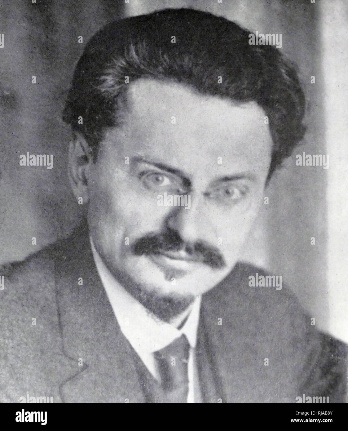 Leon Trotsky (1879 – 1940); Marxist revolutionary, theorist, and Soviet politician. Initially supporting the Menshevik Internationalists faction within the Russian Social Democratic Labour Party, he joined the Bolsheviks ('majority') just before the 1917 October Revolution, immediately becoming a leader within the Communist Party. He would go on to become one of the seven members of the first Politburo, founded in 1917 to manage the Bolshevik Revolution - Stock Image
